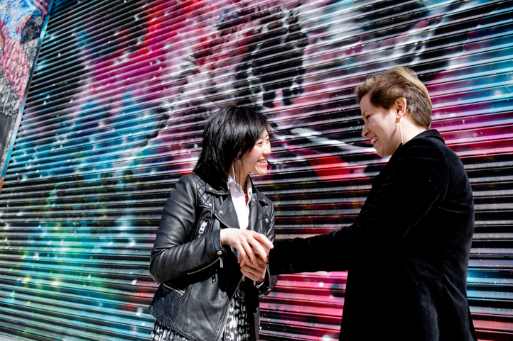 04_CarlyGaebe_SteadfastStudio_EngagementPhotography_Gay_Lesbian_Brooklyn_Colorful_BushwickMural.jpg