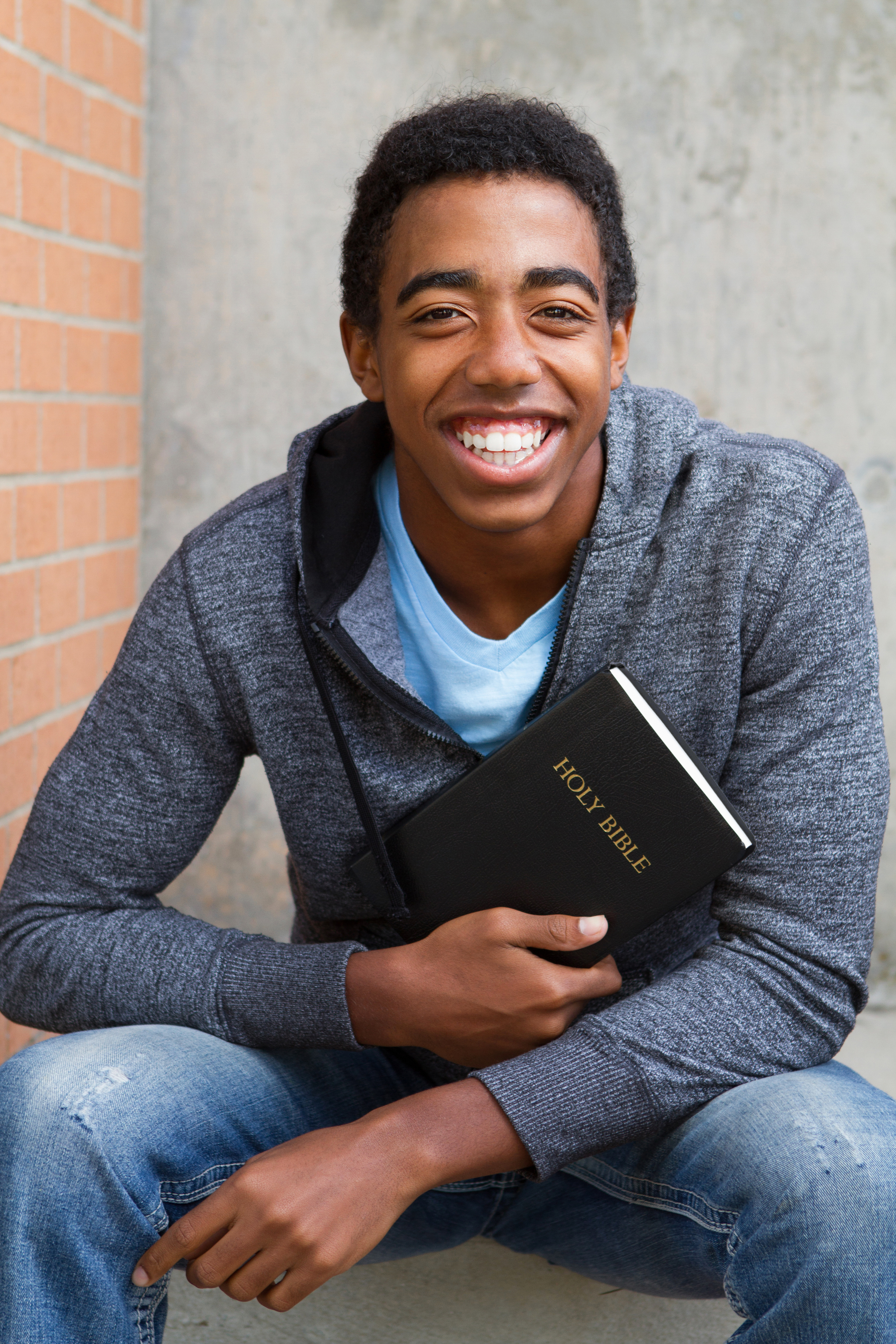 teenager holding a bible