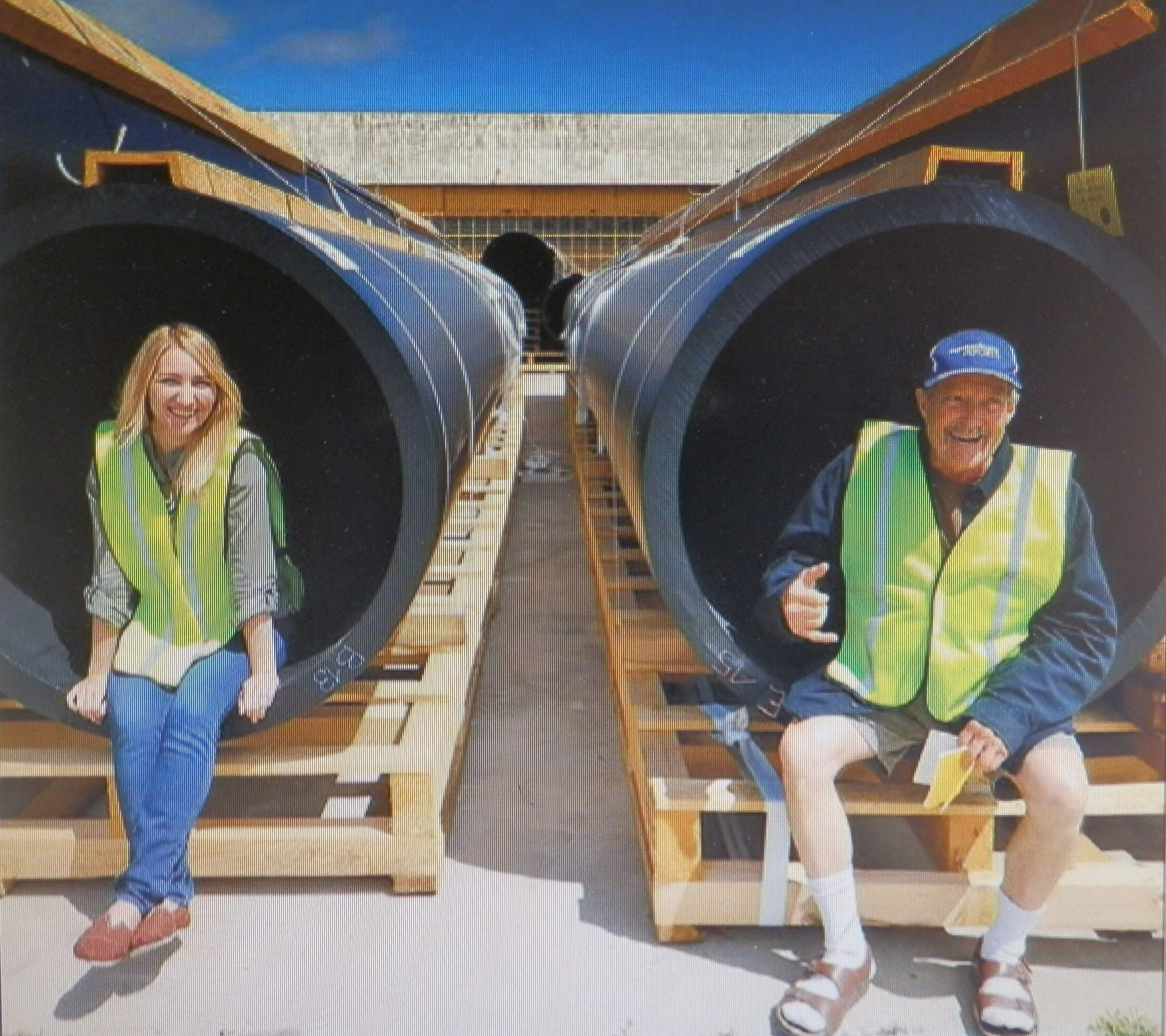"""Katie Allen and Captain Moore sit on some of the parts of """"Wilson"""" last May"""
