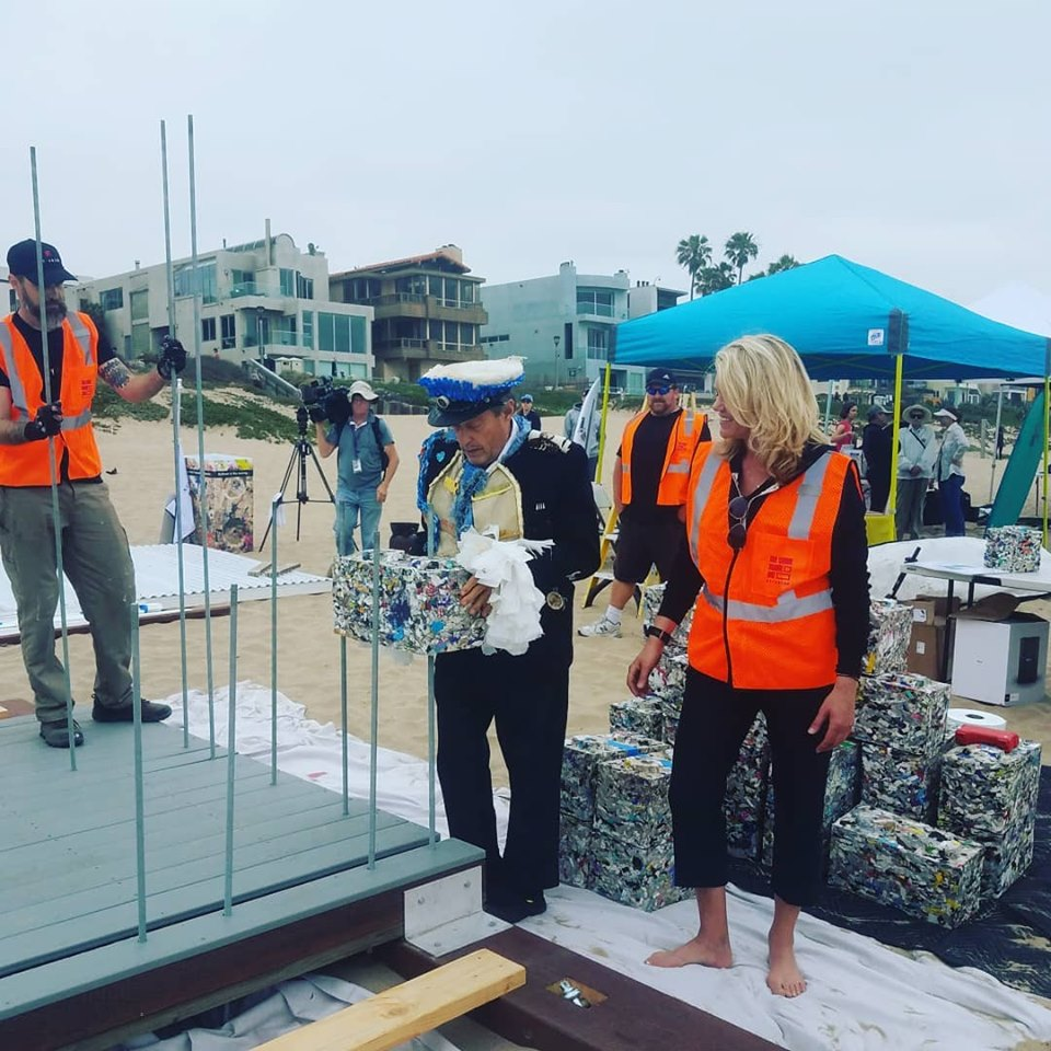 6_8 laying recycled plastic block manhattan bch guard station.jpg