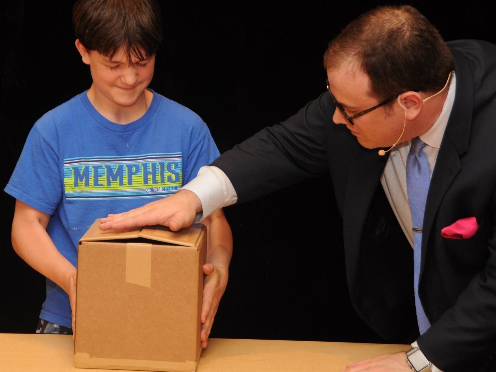To teach empathy and demonstrate how bullying victims can feel, a student is suddenly unable to lift a small cardboard box.