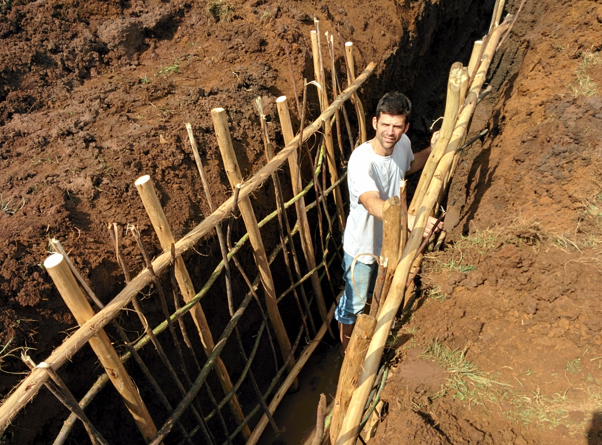 Josh Leinbach leading in the construction of a fresh water well.