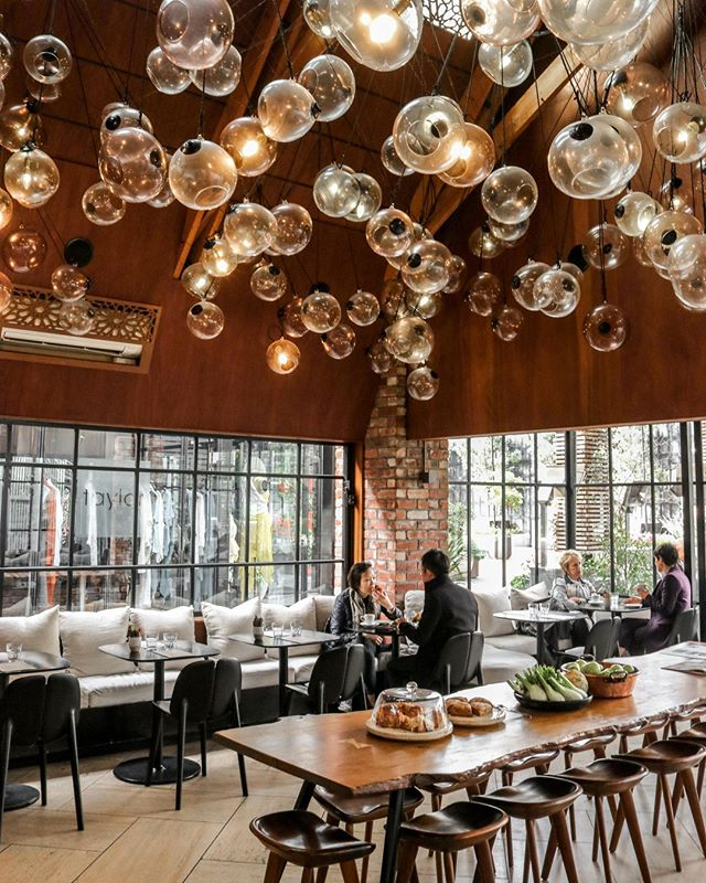 Whether inside or out, Ortolana sits under a blanket of lights - the interior sky hand-crafted by Monmouth Glass Studio. #Hipgrouplife #SeasonalProduce #OrtolanaNZ #BritomartNZ