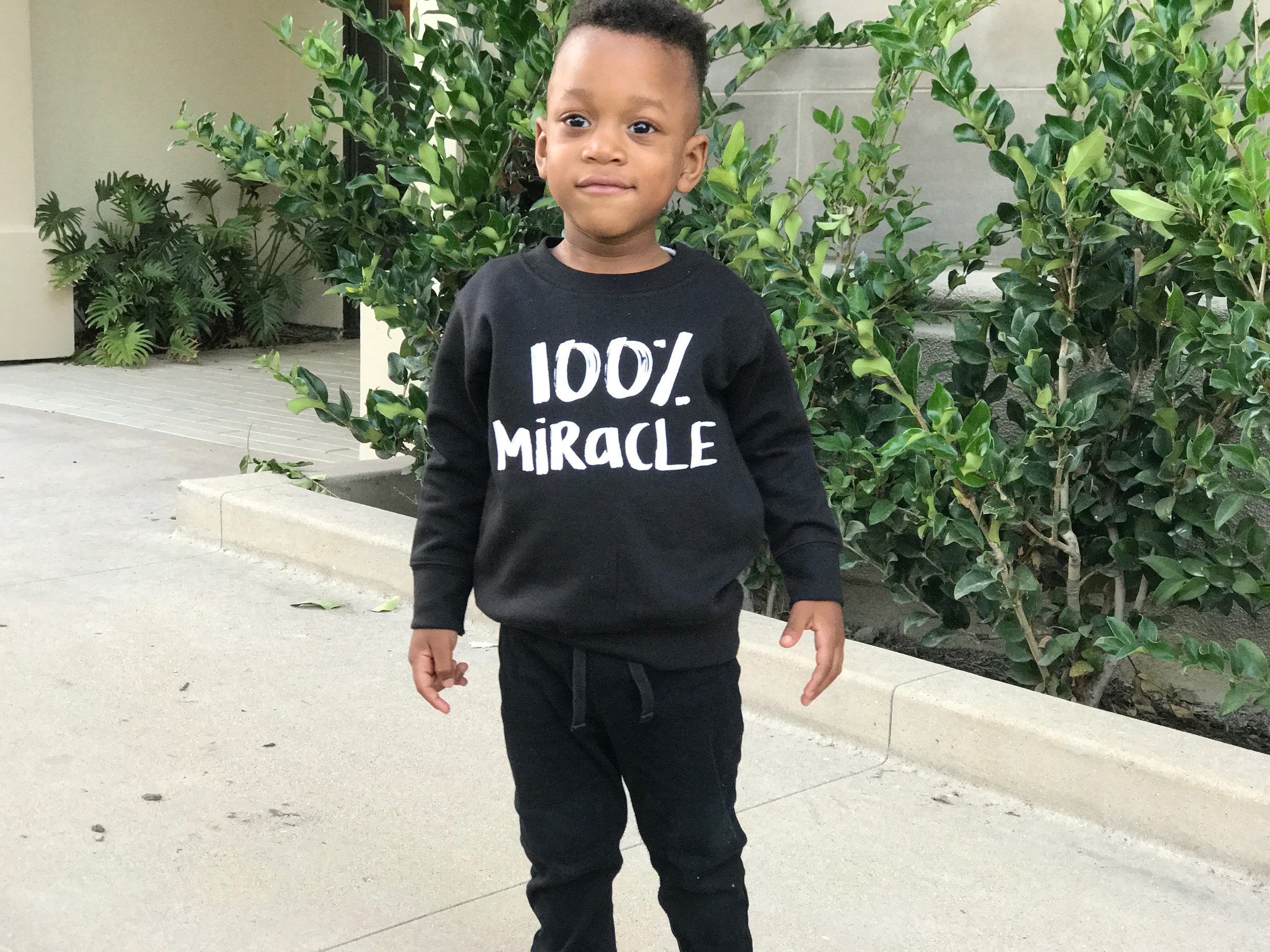 100% Miracle Sweater is from  Halos & Miracles
