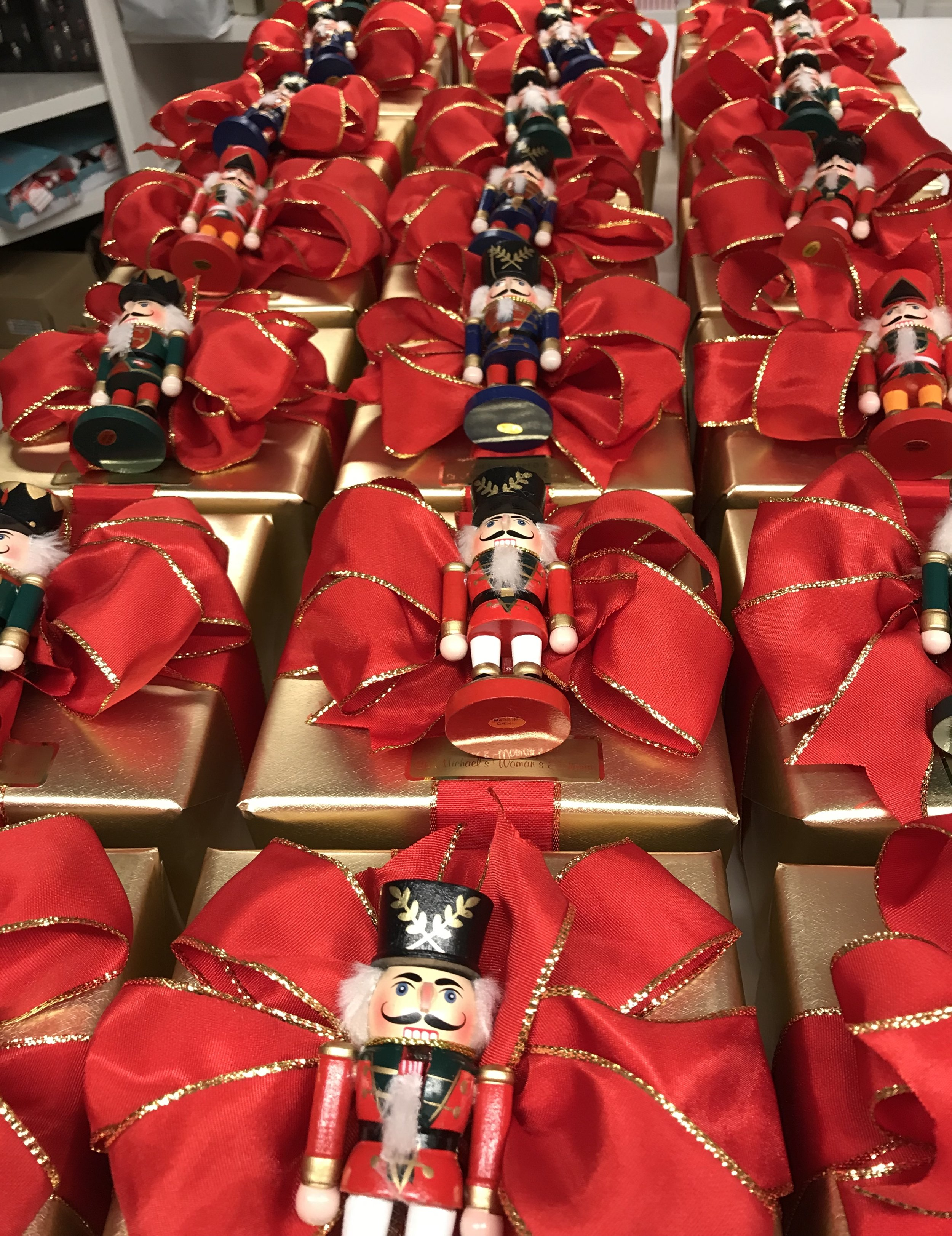An order for 100 corporate Christmas gifts all lined up looking like toy soldiers.