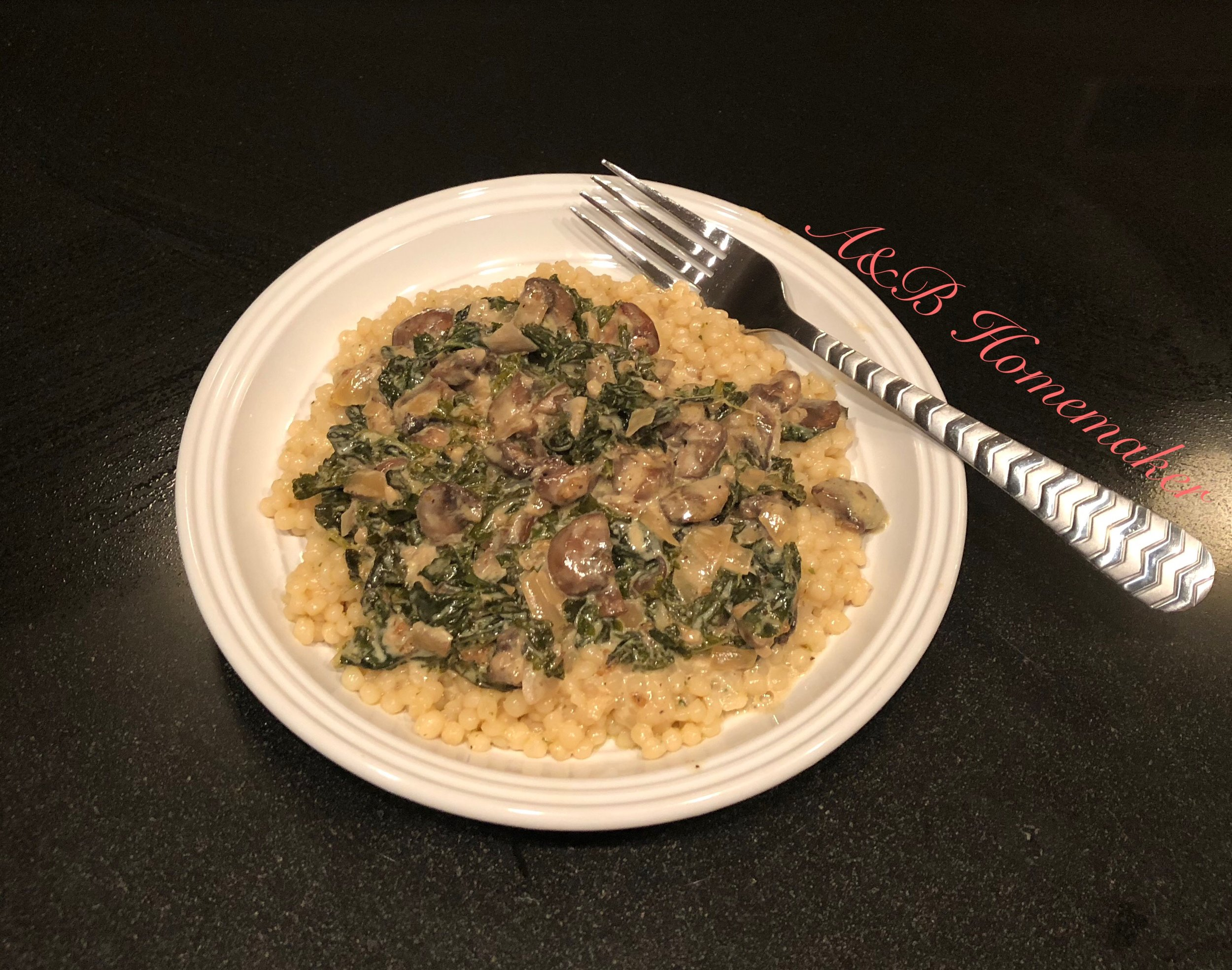 Creamy kale and mushroom sauce over couscous