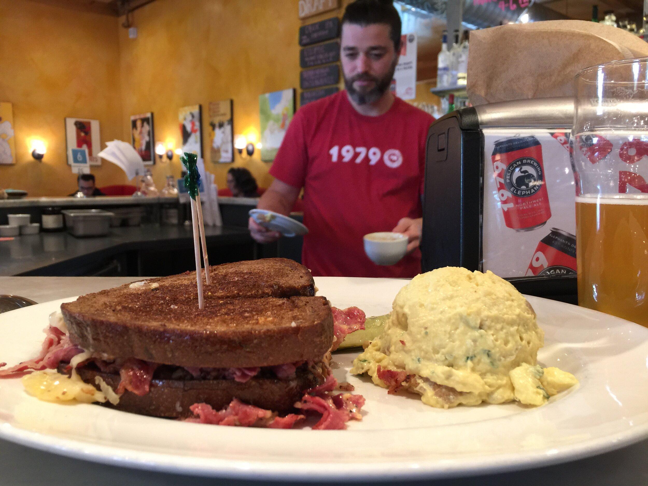 A delicious Reuben sandwich at Elephants on Corbett, Portland, Oregon (Josh in the background)