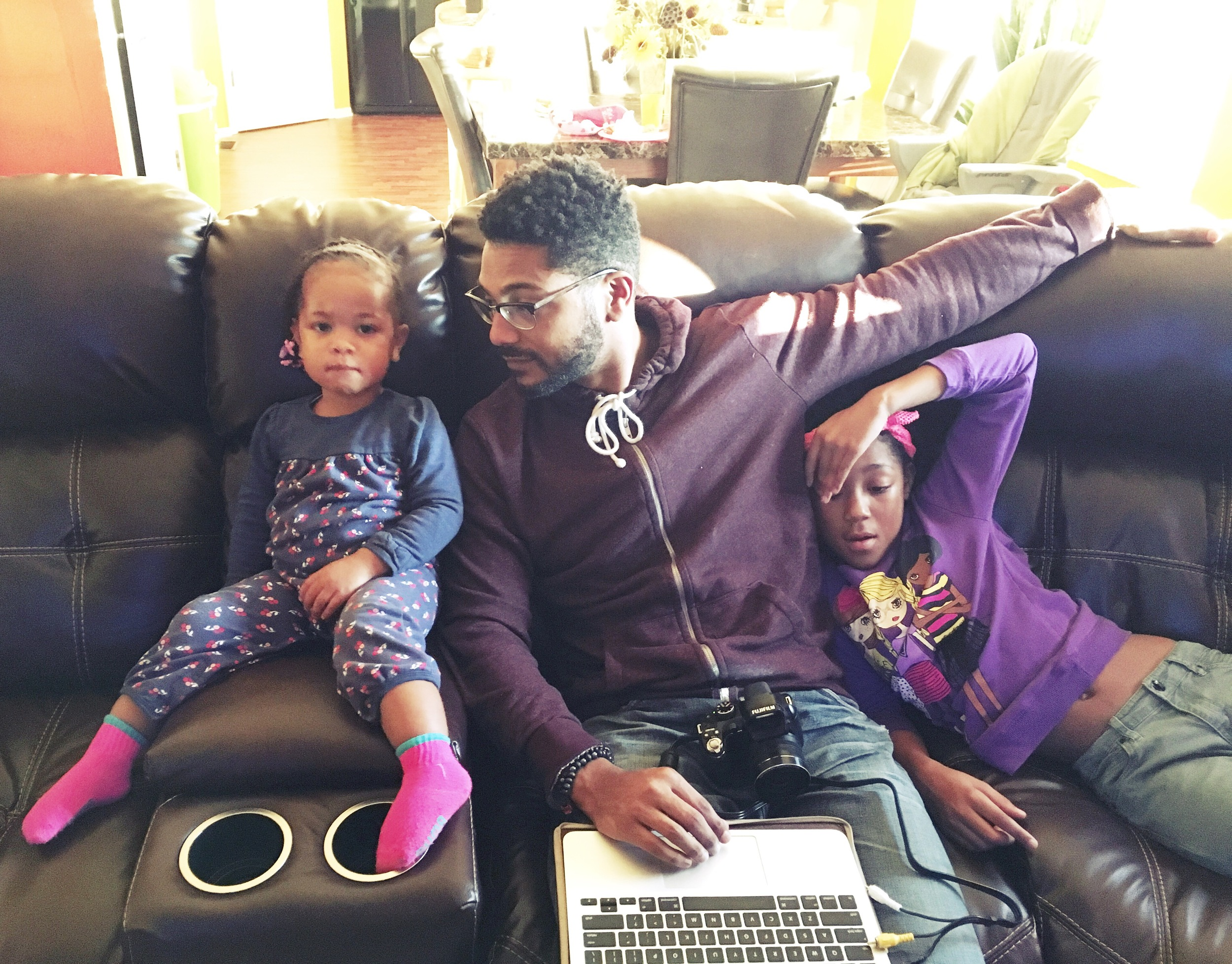 Daddy writing a paper but keeping his girls close.