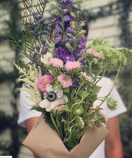 A bouquet of seasonal & locally grown flowers arranged by Bloom Flower Truck and delivered to your door.