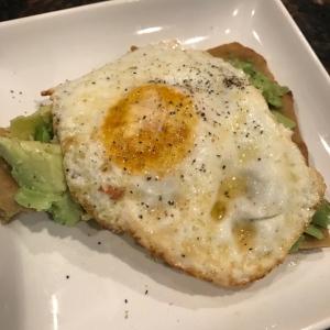 fried egg with smashed avocado