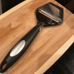 Cheese slicer doubling as a zucchini lasagna slicer.