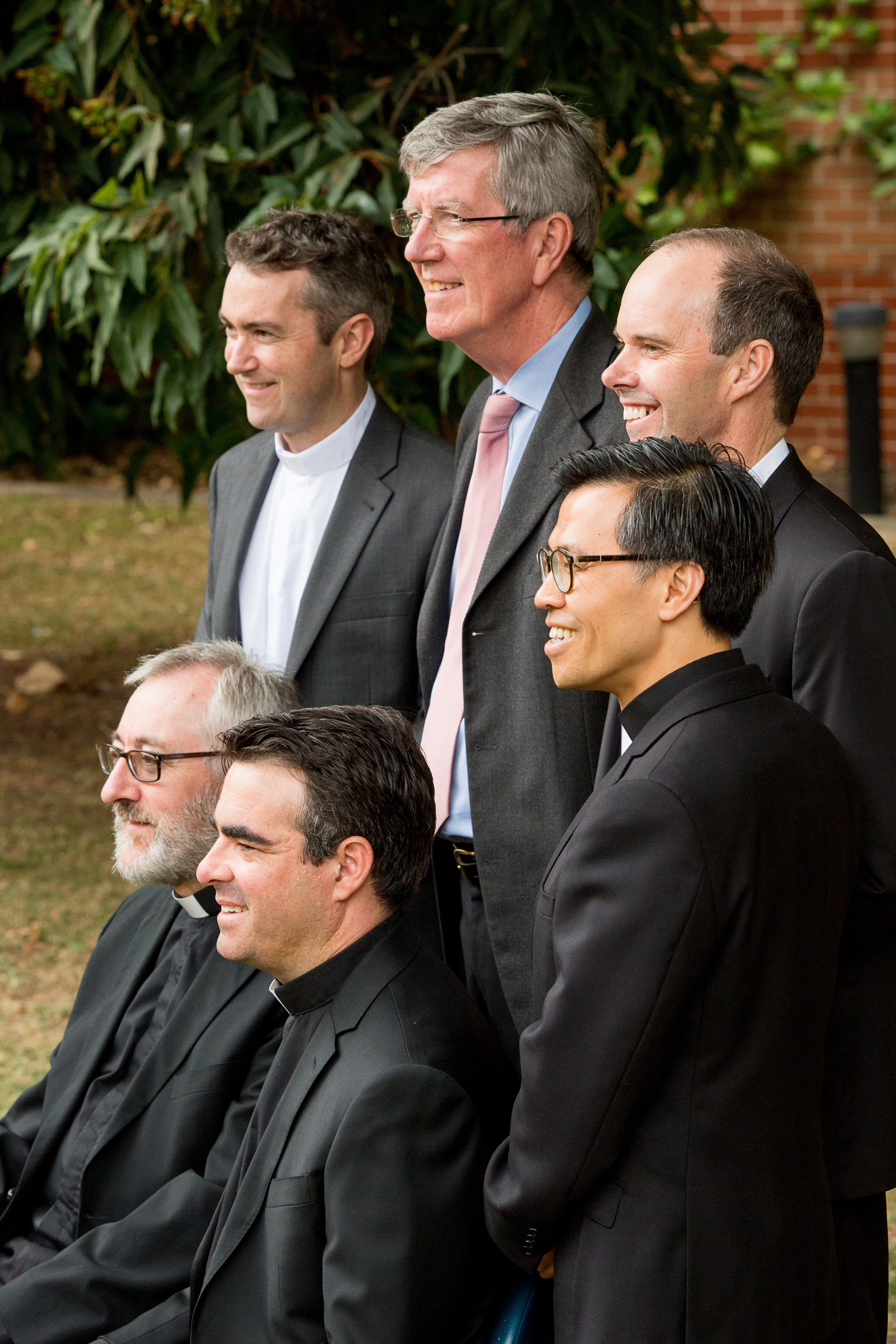 Fr Jake Mudge, far back left, with the staff at Corpus Christi College.
