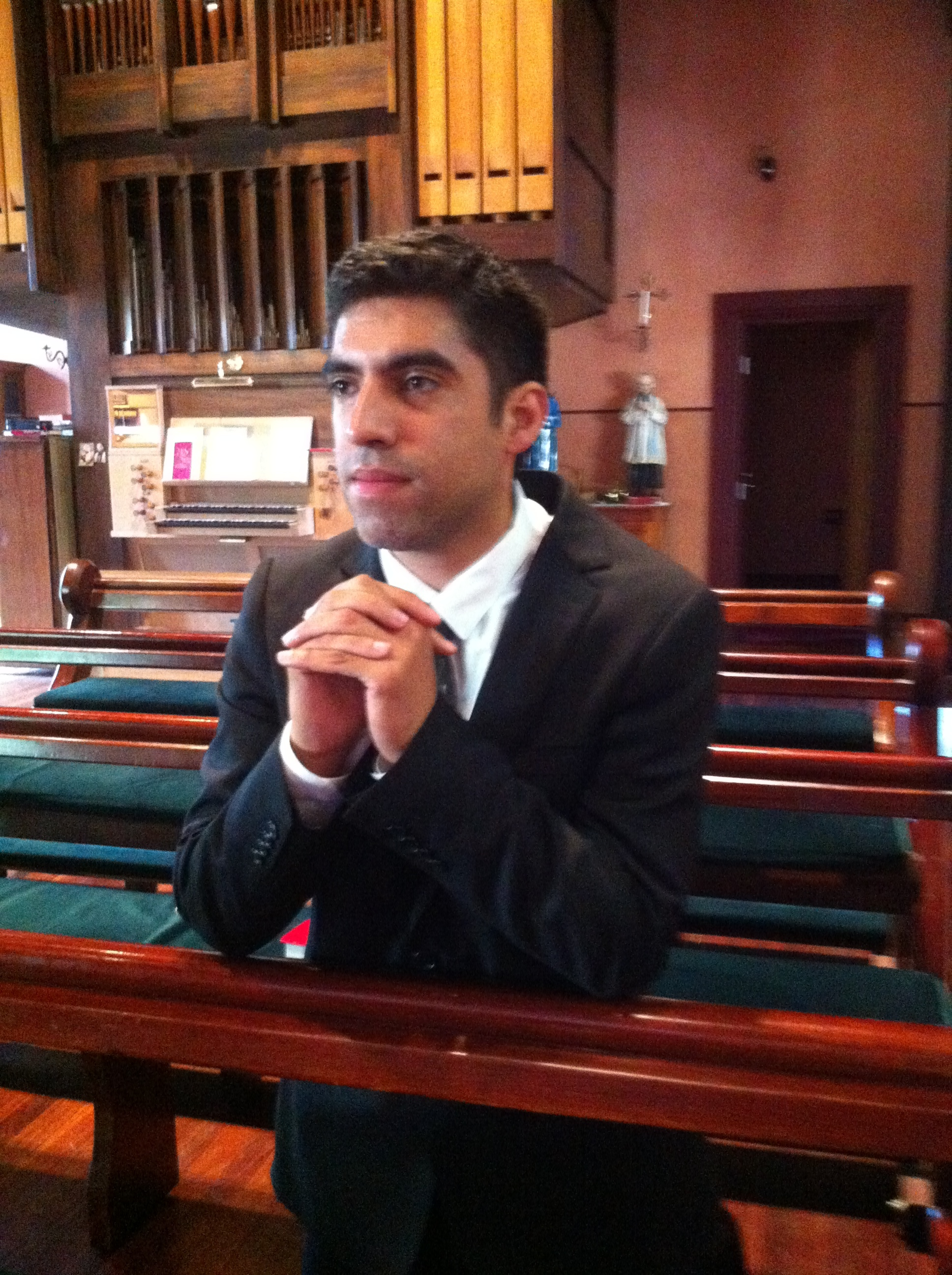 Christhian prays in the chapel at Corpus Christi College, Carlton.