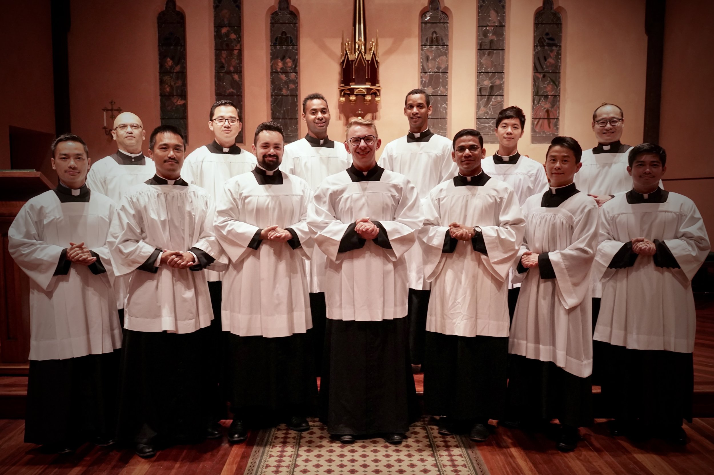 The seminary schola:      Back (left to right): Mark Hughes, Joseph Aung, Jean-Sebastien Gery, Chris Gery, Peter Nguyen and Matthias Kim.      Front (left to right): Tien Tran, Jaycee Napoles, Samuel Pearson, Olek Stirrat, Simeon Anthony, Andrew Choi and Allan Aclan.