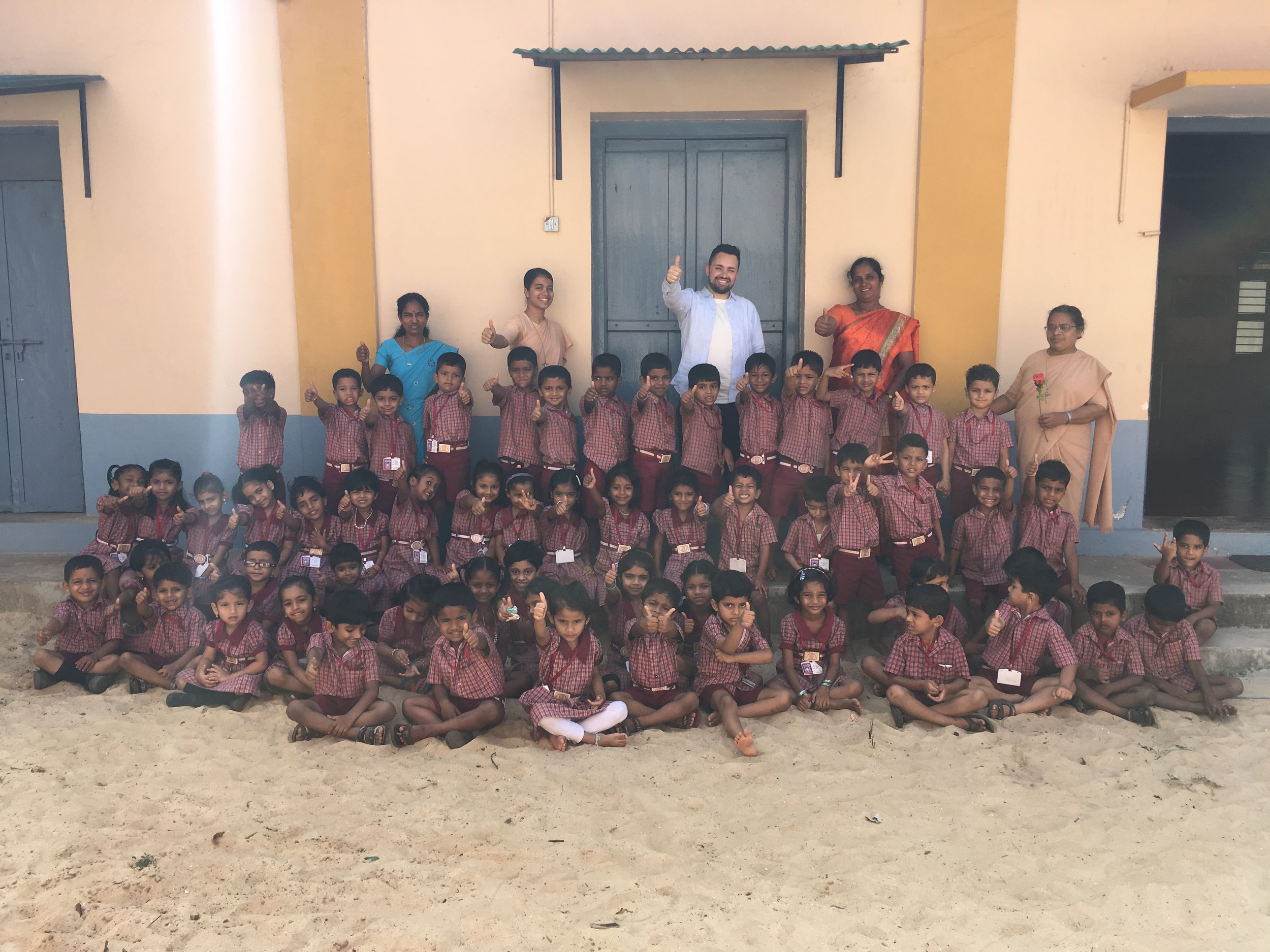 Samuel Pearson with students and teachers at the local Catholic primary school of the parish he stayed at in India.