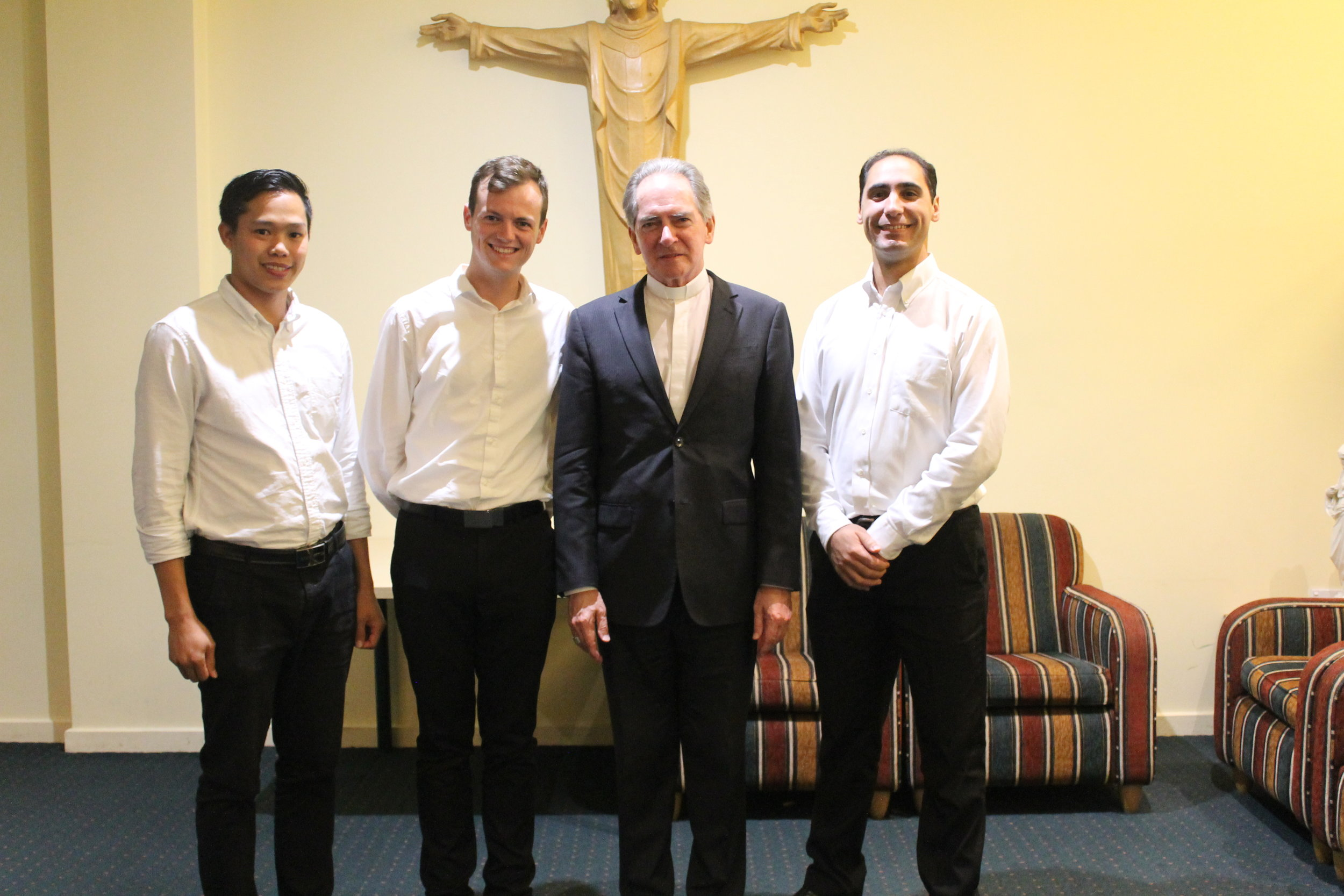 Bishop Paul Bird of Ballarat with his seminarians (from left to right), Peter Cay, Bill Lowry and Matthew Restall.
