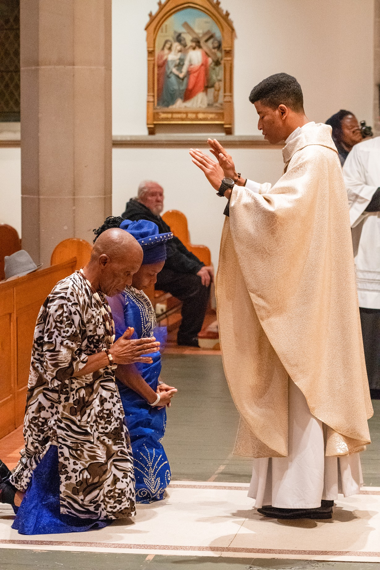 Fr Fidelis Udousoro gives his first blessing to his parents after his ordination at St Mary's Cathedral in the Hobart Archdiocese.