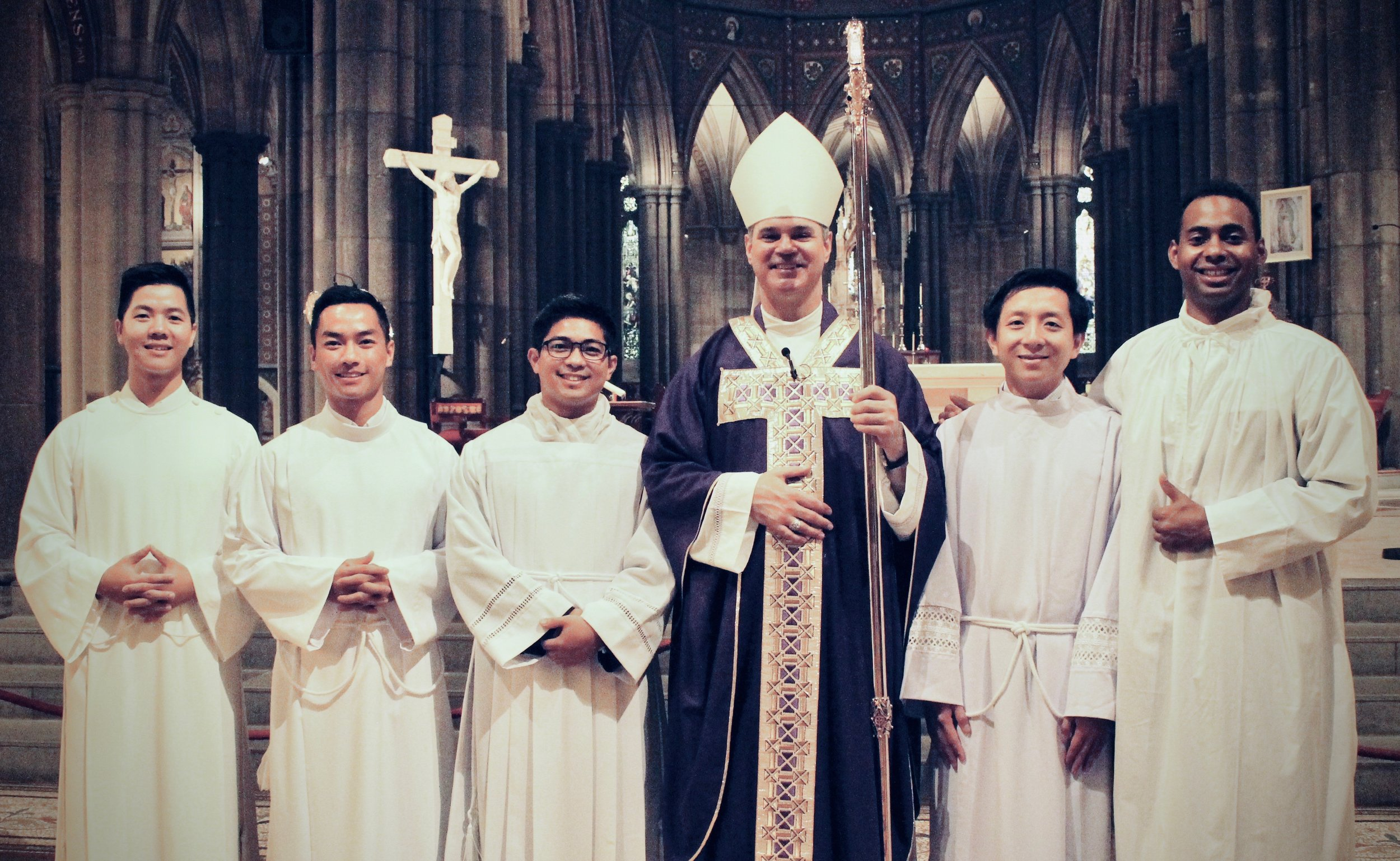 Lectors Peter Nguyen, Tien Tran, Allan Aclan, An Hoang Le and, Jean-Sebastien Gery with Archbishop Peter Comensoli (centre).