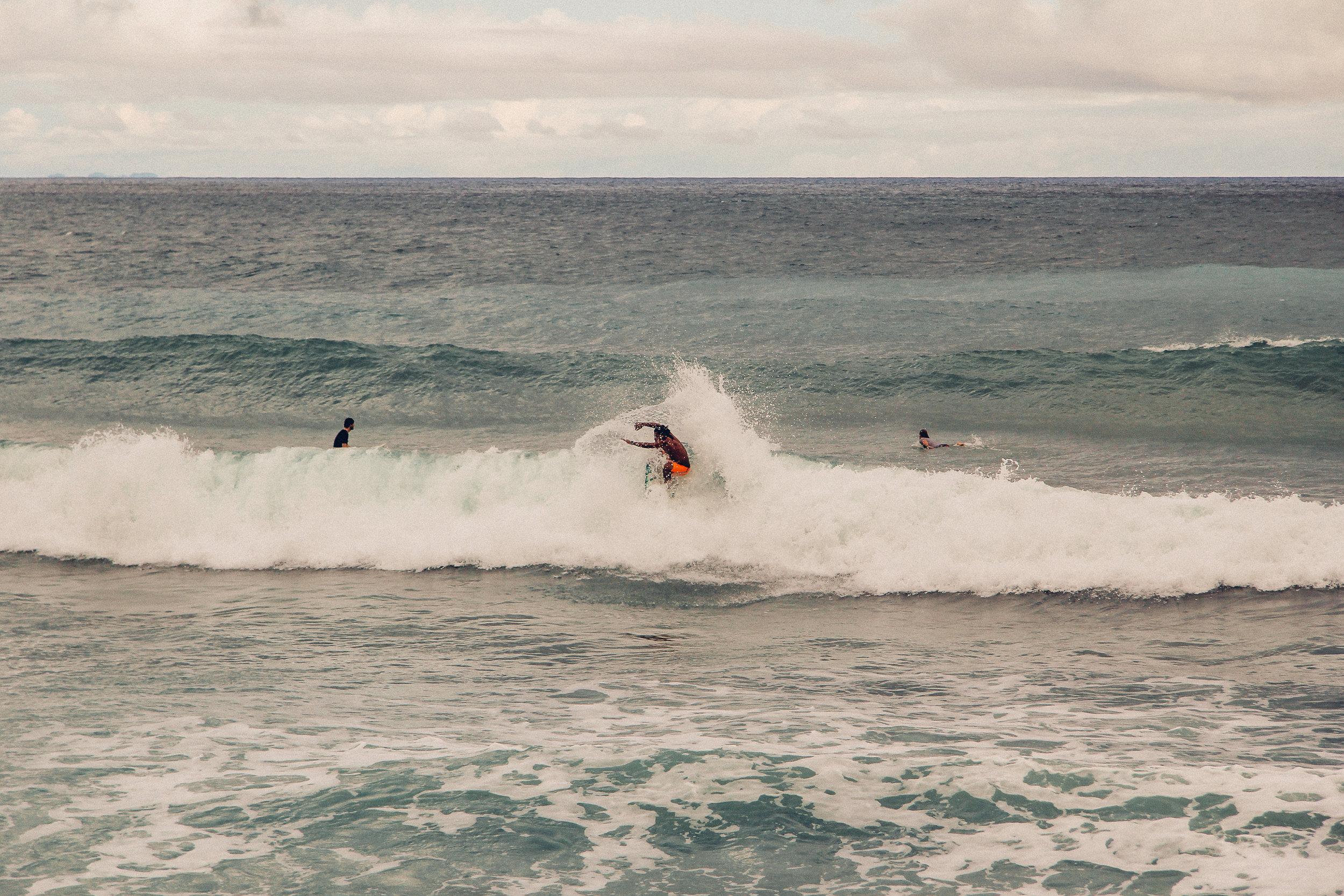 Surfing the beach breaks at Playa Santa Teresa.