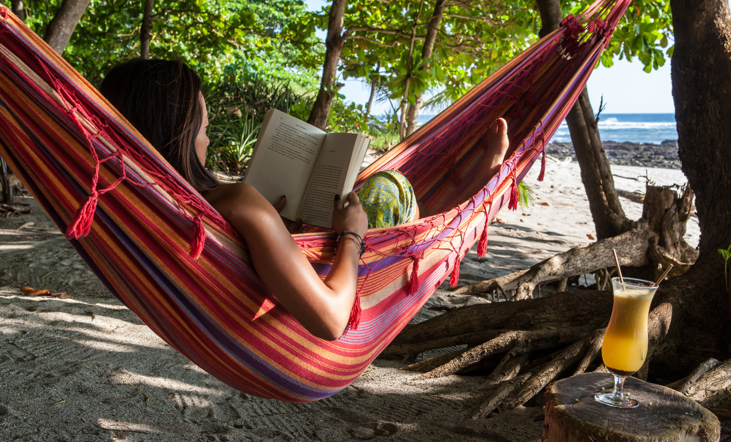 Relaxing in a hammock with a good book is an ideal way to recover between surf sessions