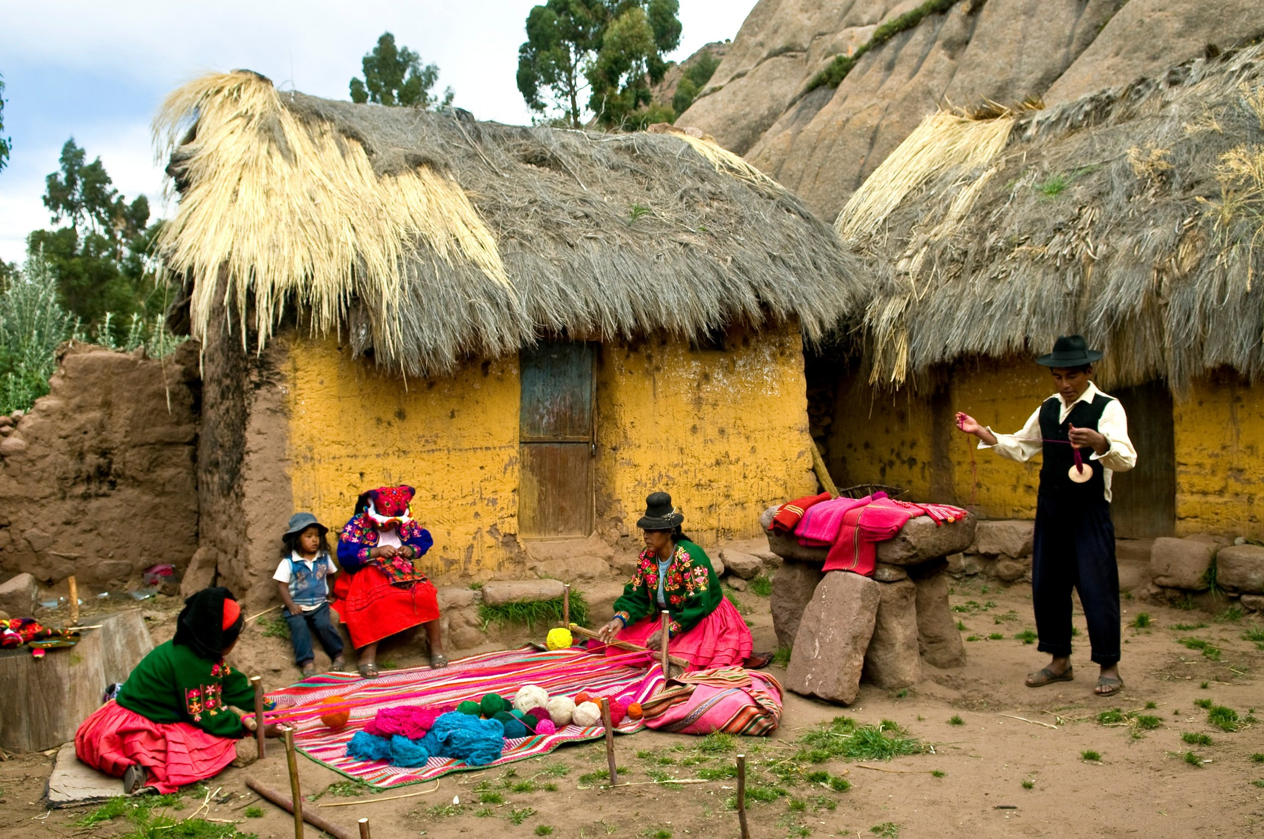 Private weaving demonstration on Amantani Island. In contrast to nearby Taquile, where men do the weaving, women are head of the communities and handle to weaving on Amantani.