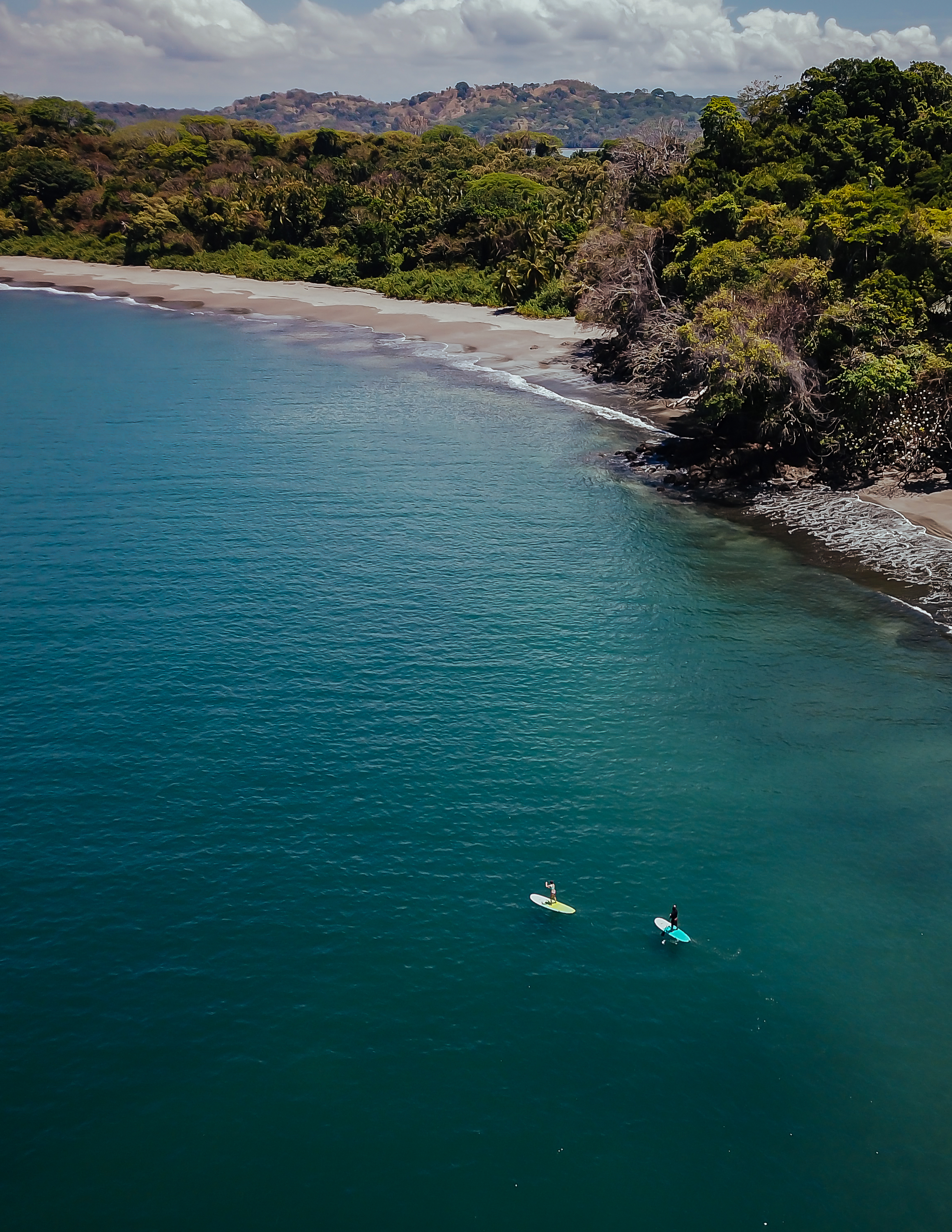 Paddle boarding off the coast of Isla Palenque