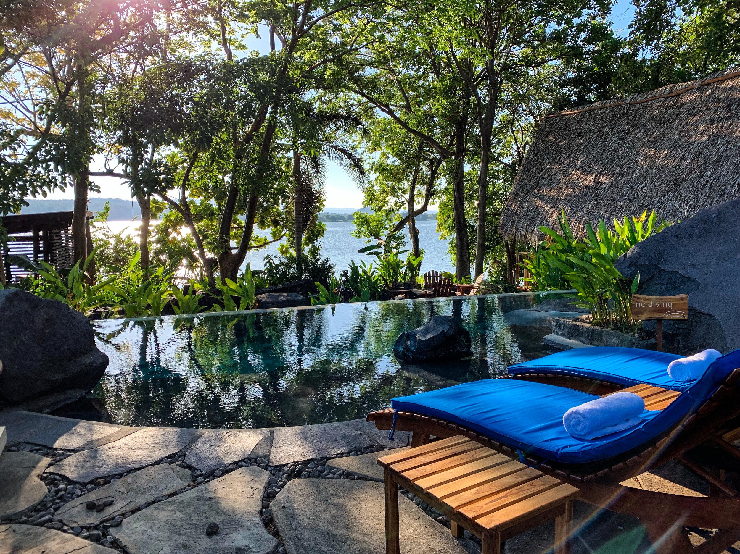 Serene lake views from the pool deck at Jicaro Island Lodge.