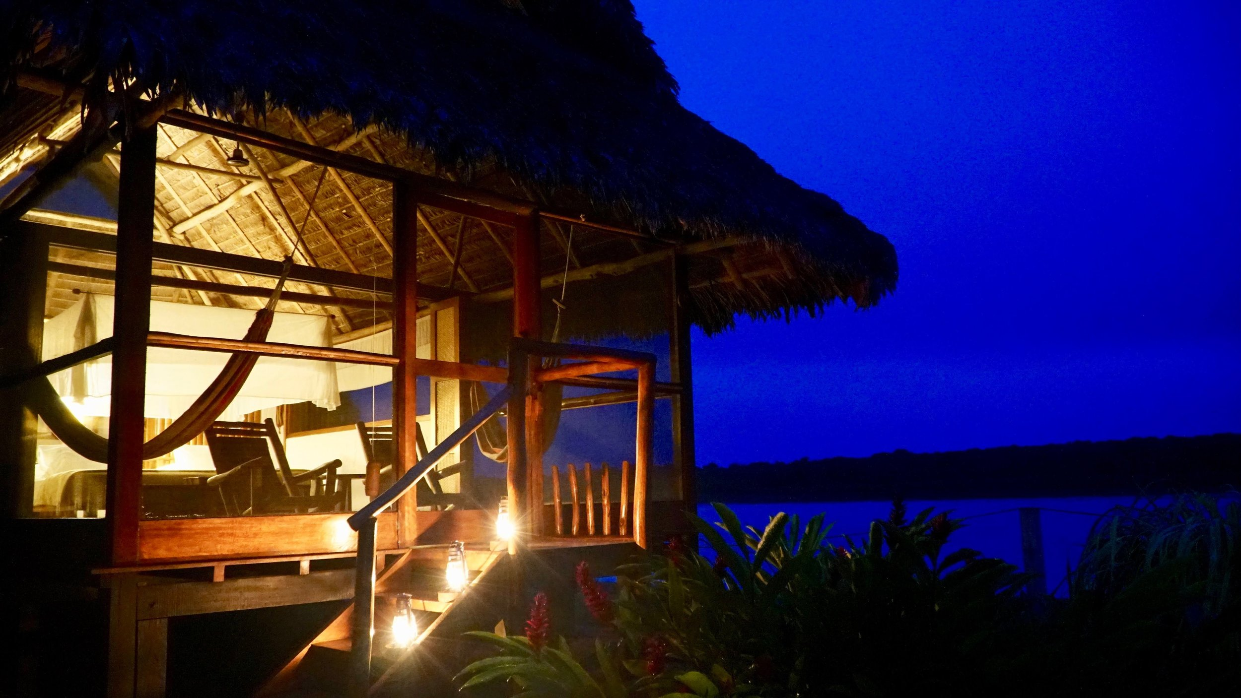 A Superior Rio Cabana at night at Inkaterra Reserva Amazonica