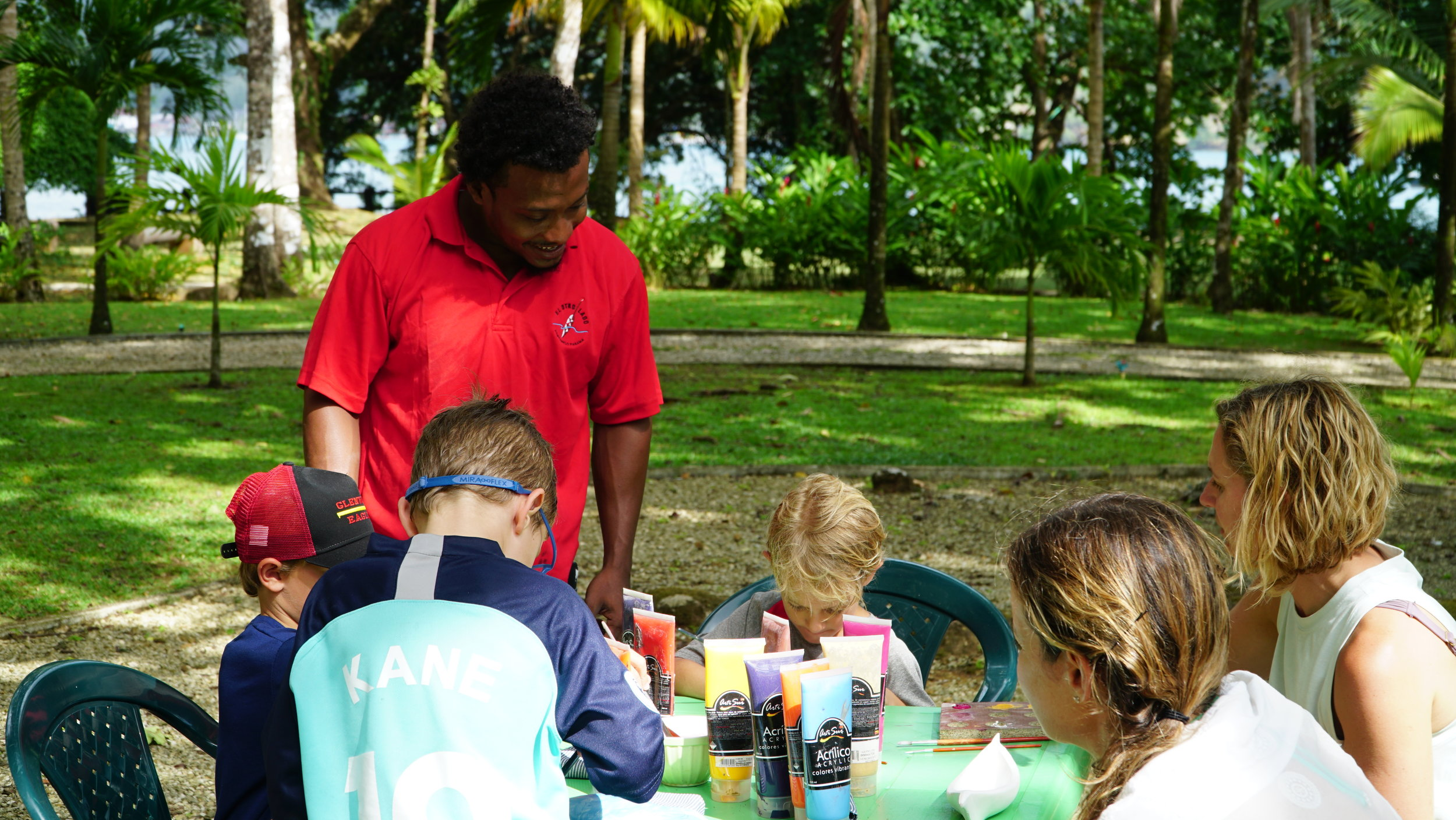 A local artist leads a painting class at El Otro Lado, a fun experience for adults and children alike.