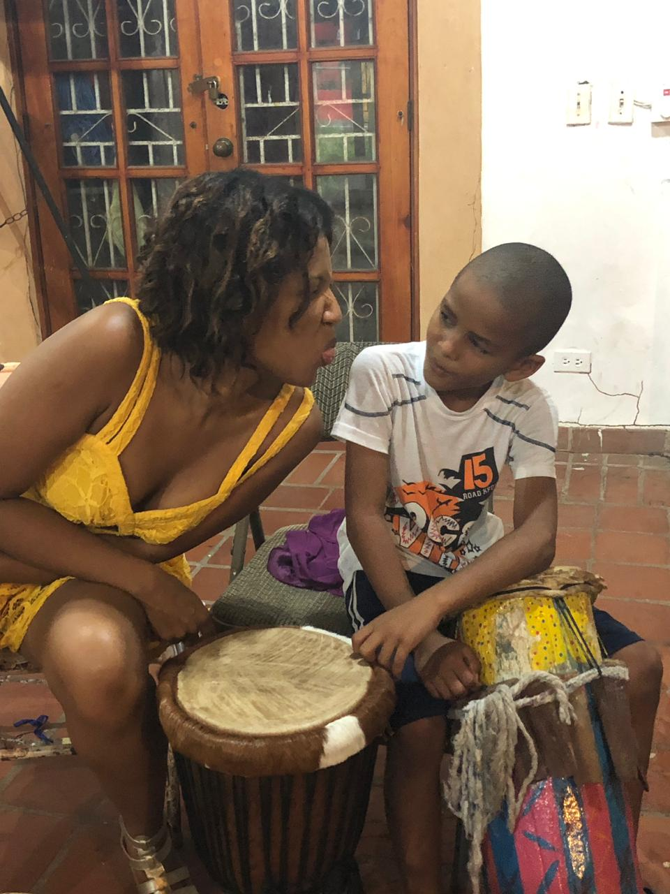 Diosamary Loré, Director of Sales at El Otro Lado, clowns around with Elian 8-year old student at the Little Rhythm School which provides local kids with free musical classes with support of the Bahia Portobelo Foundation.