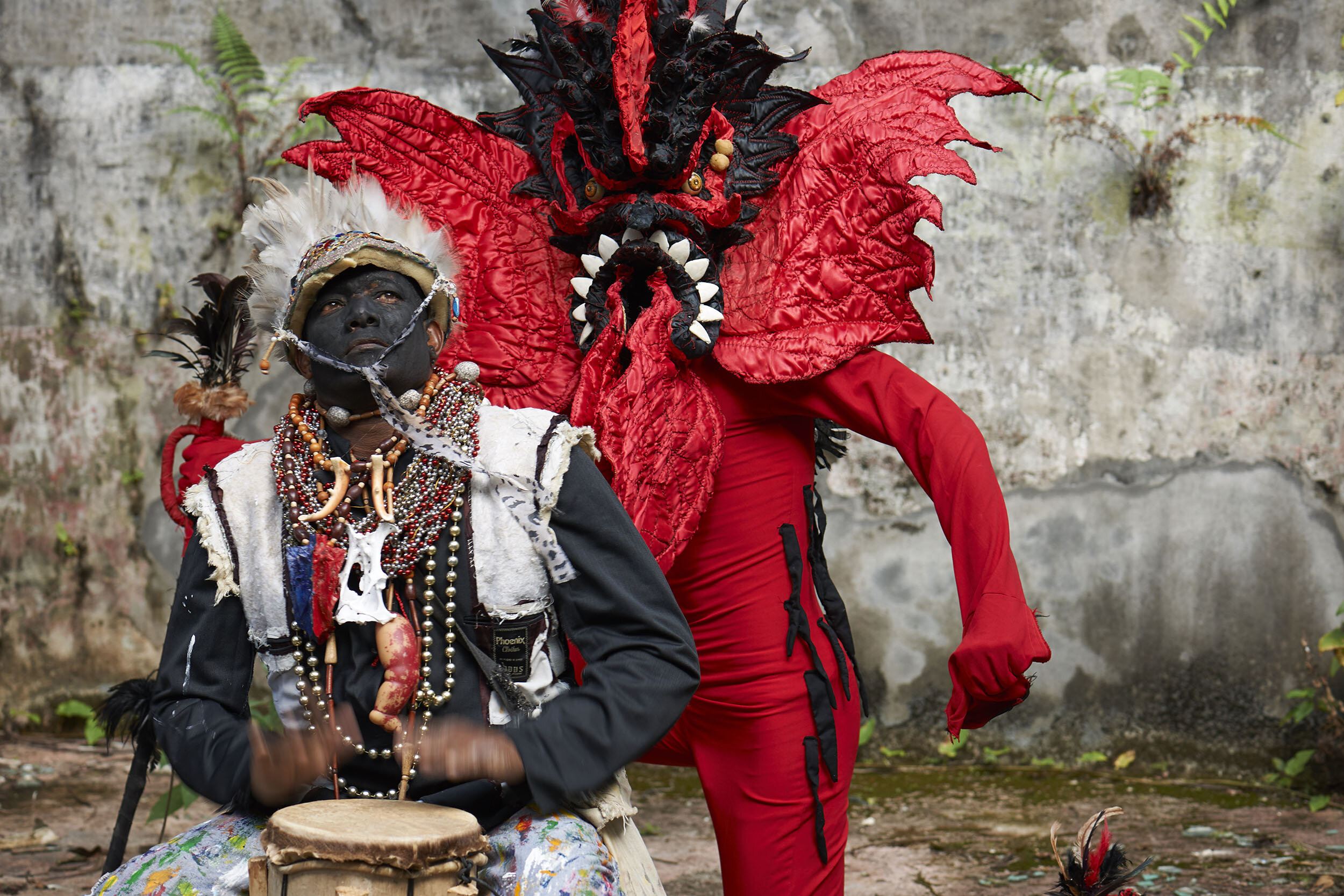 Congo Festival performers dressed as Cimarrones (seated) and Diablos (the Spanish colonists.)