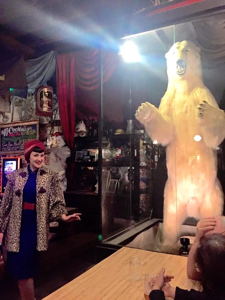 Allyson posing with a HUGE polar bear!