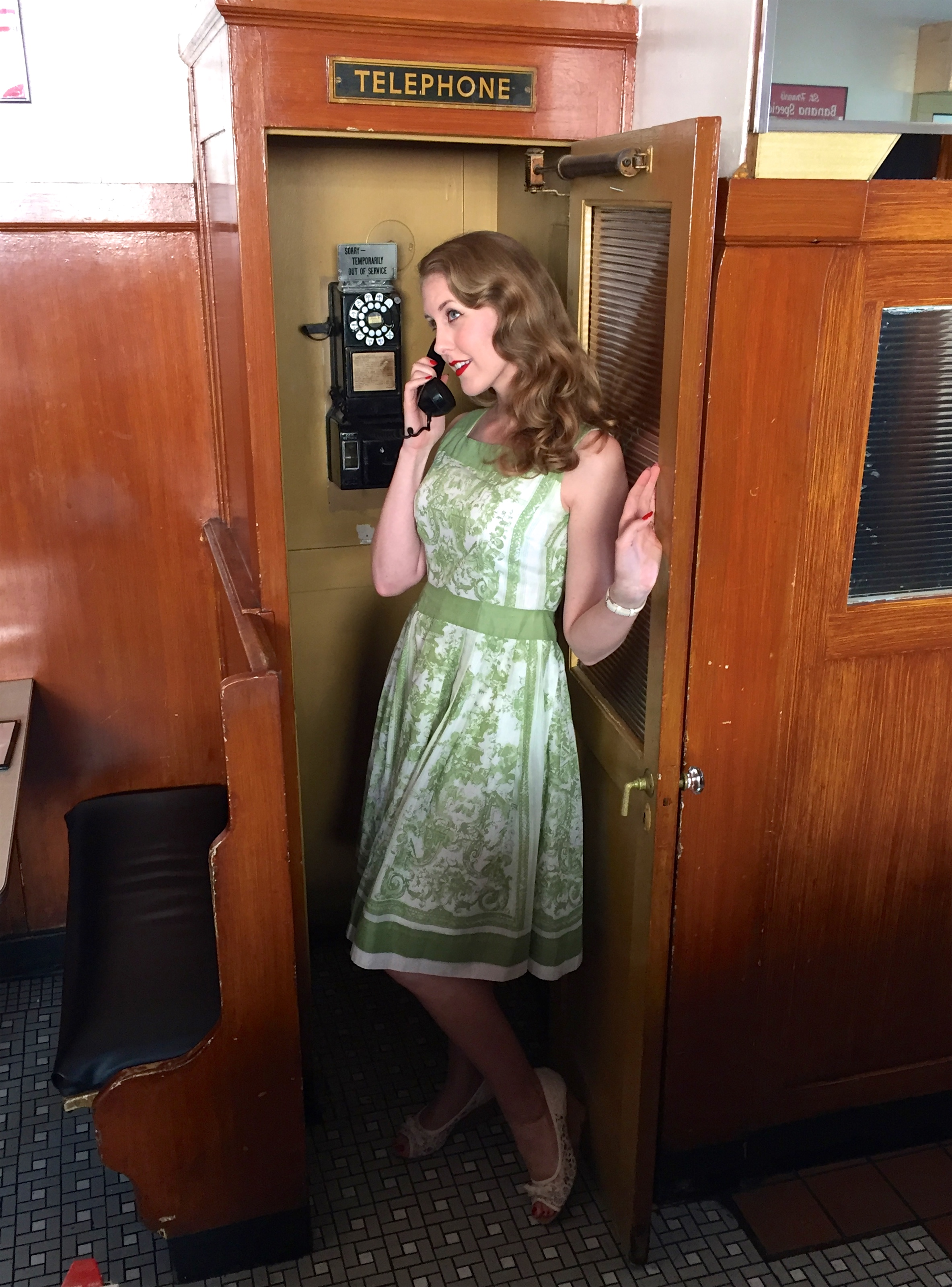 Katrina having fun with the phone booth
