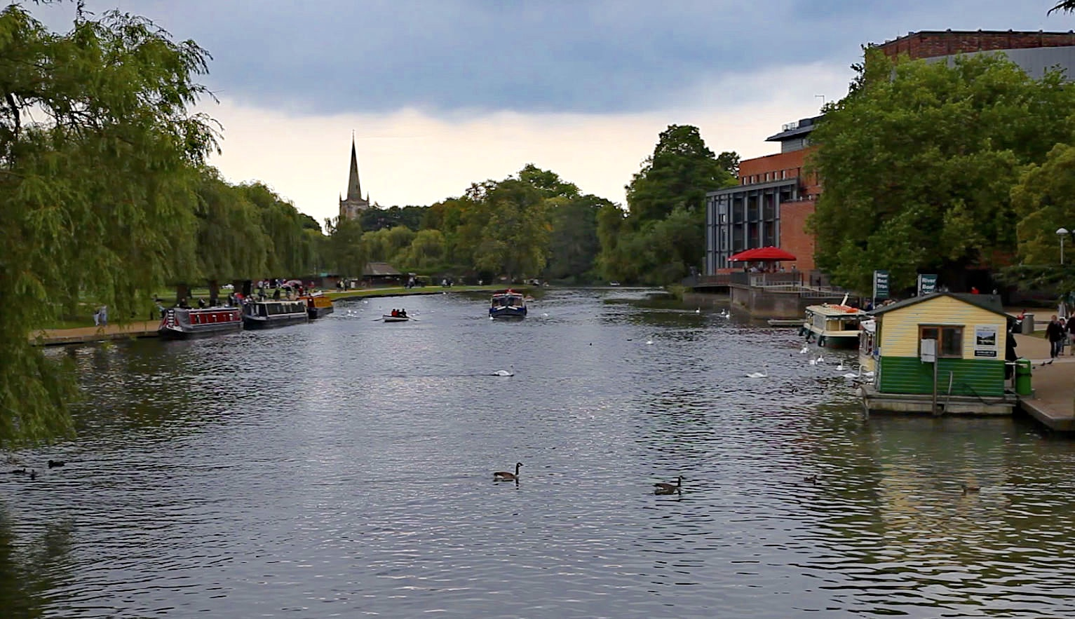 Looking down the Avon towards the spire of Holy Trinity Church with the Shakespeare Theatre on the right. Photo by Edward Burman