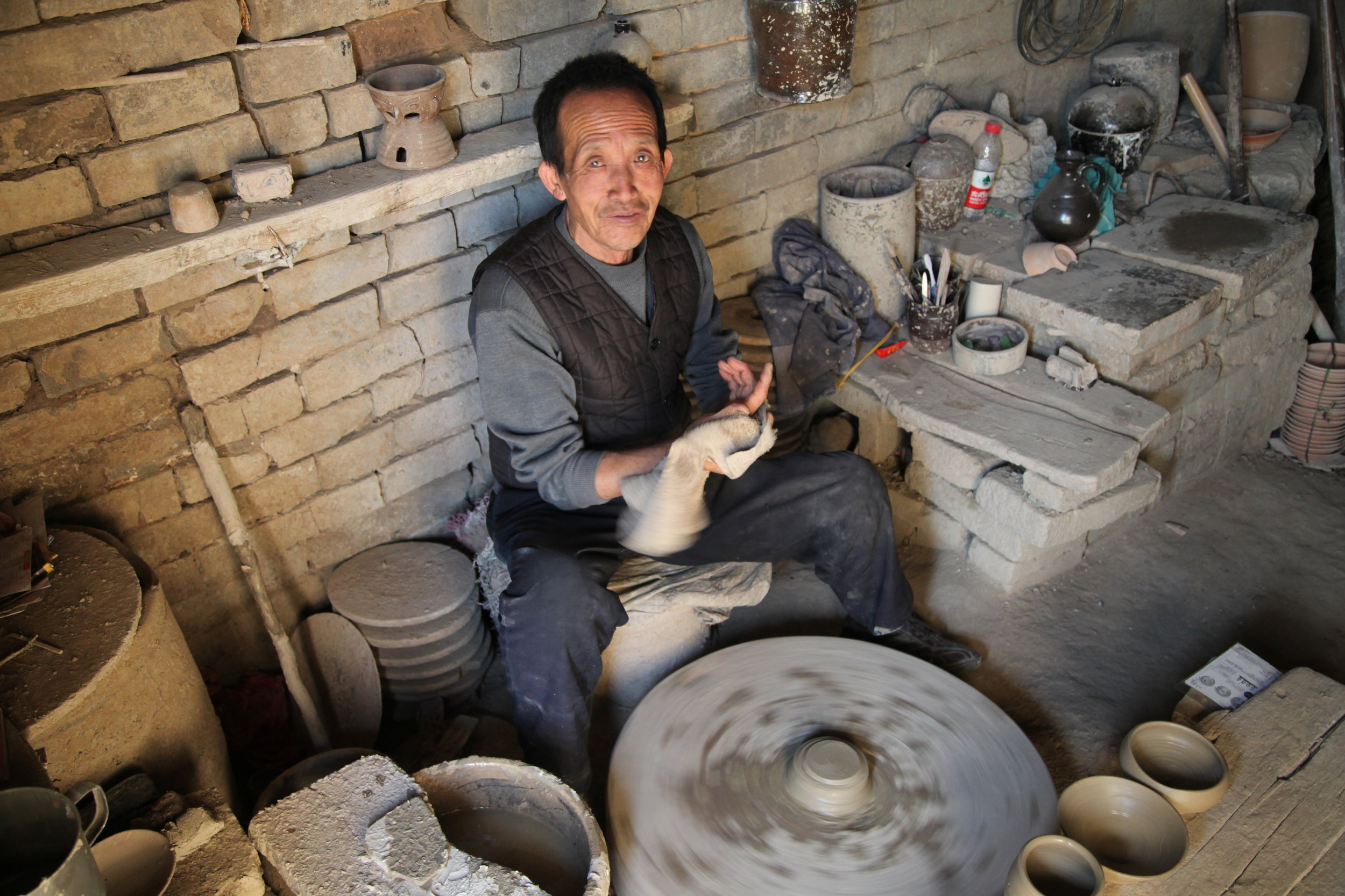 Here is a Zhou family potter in direct tenth generation succession to the founder of the family business in the 18th century
