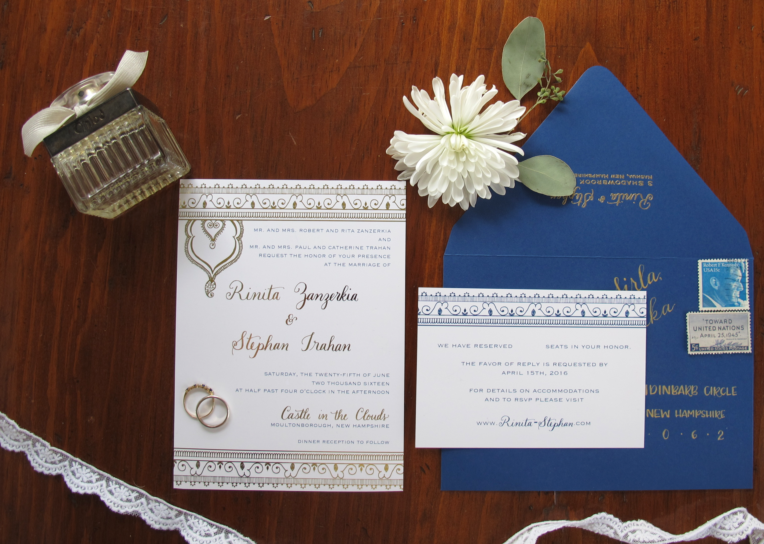 Mehndi wedding invitation suite completed with gold foil mehndi design from the bride's henna and navy lettering coordinating with the calligraphy in gold ink on the navy envelopes