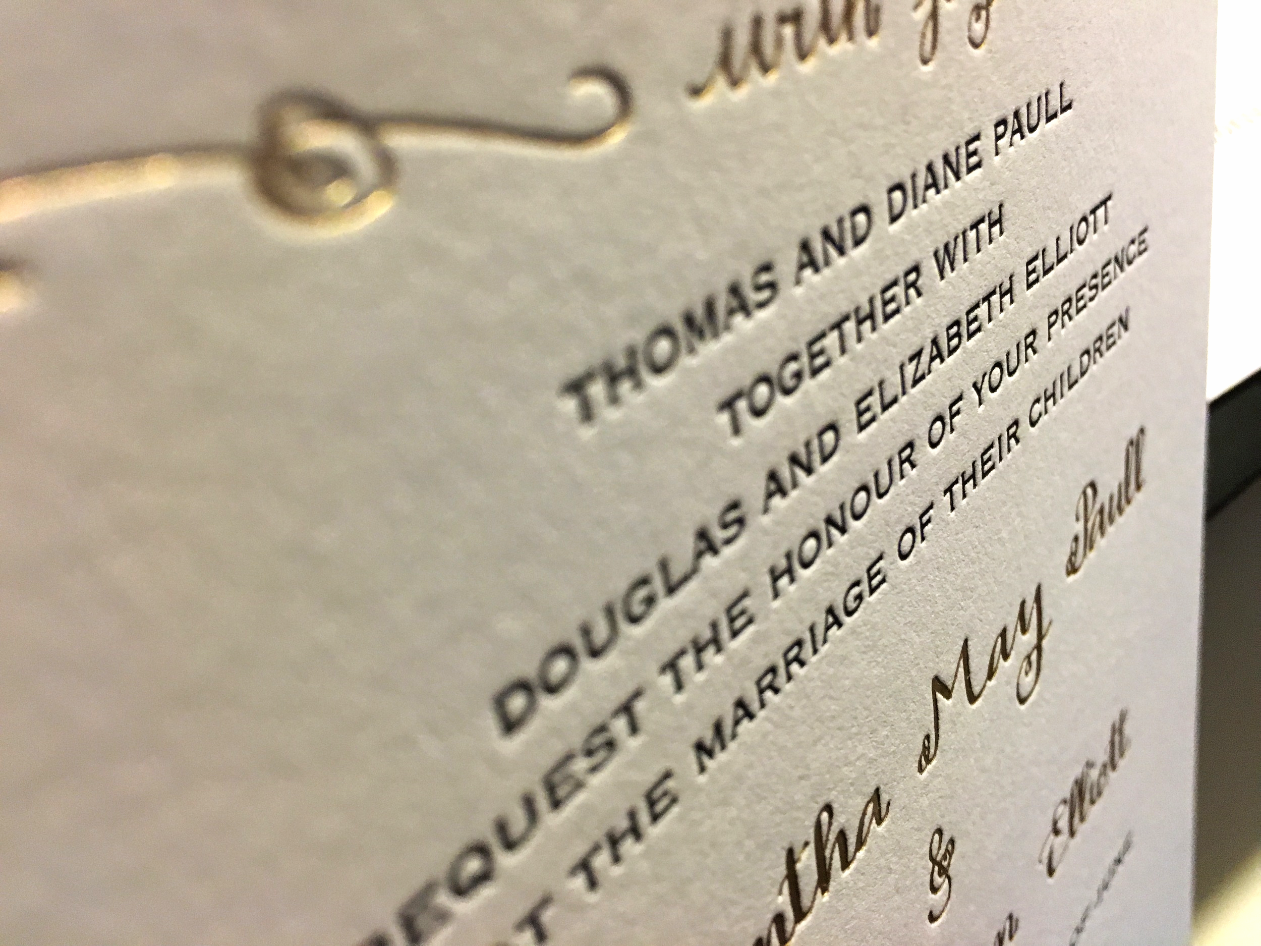 Detail of a letterpress and gold foil wedding invitation for a classic Boston wedding