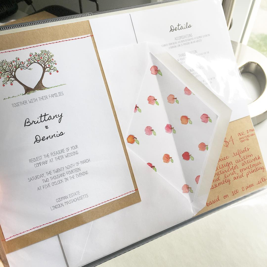 Apple Orchard Farm with watercolor heart apple trees, watercolor apple liner, and rustic sewn detail wedding invitation suite