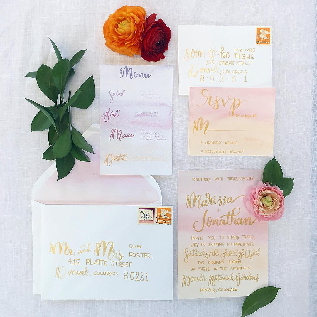 Sunrise watercolor and gold brush lettering wedding invitation suite - styled by  The Every Hostess , photo by  Colby Elizabeth Photography