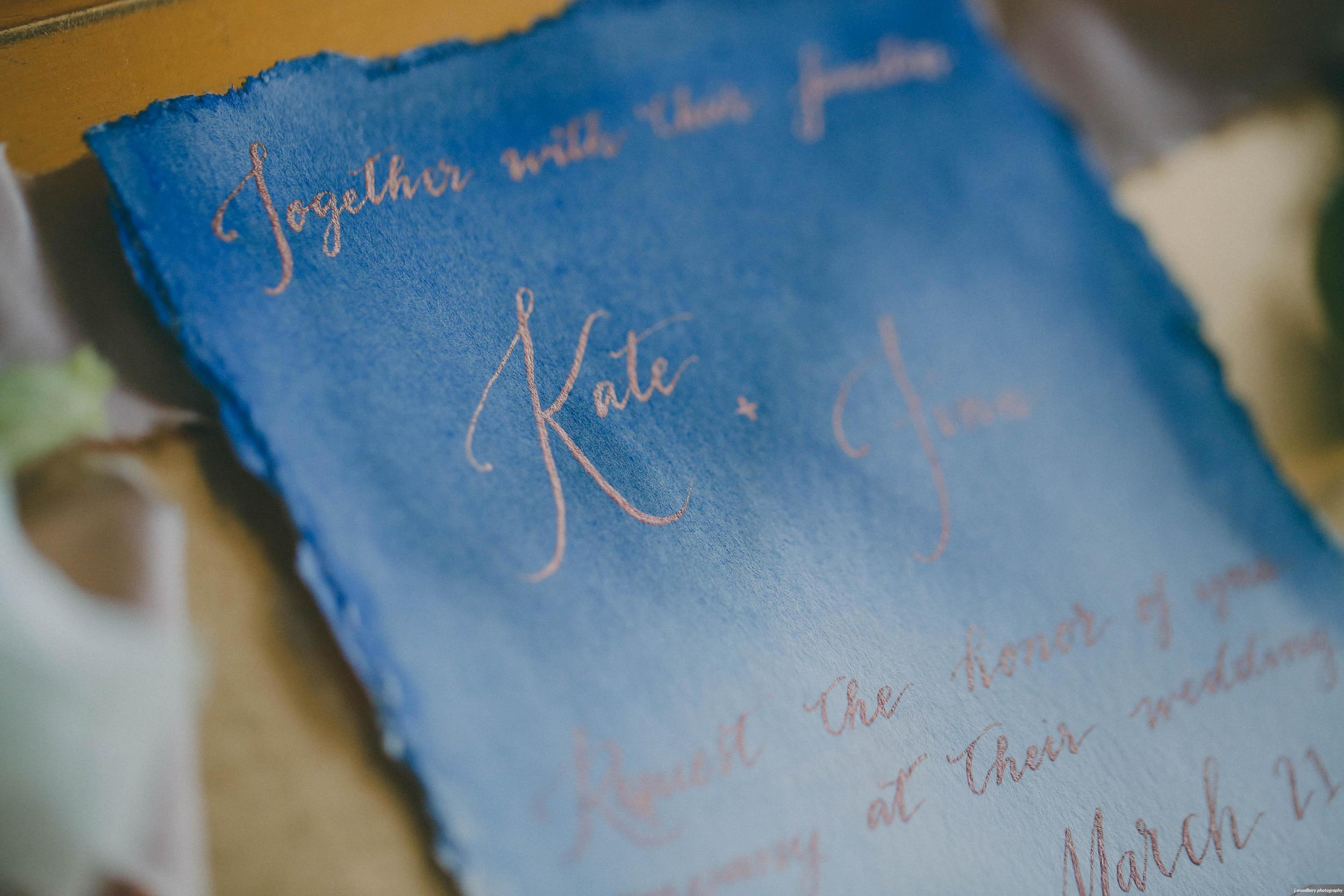 Industrial Romance Wedding Invitation with Blue Watercolor Wash and Copper Calligraphy