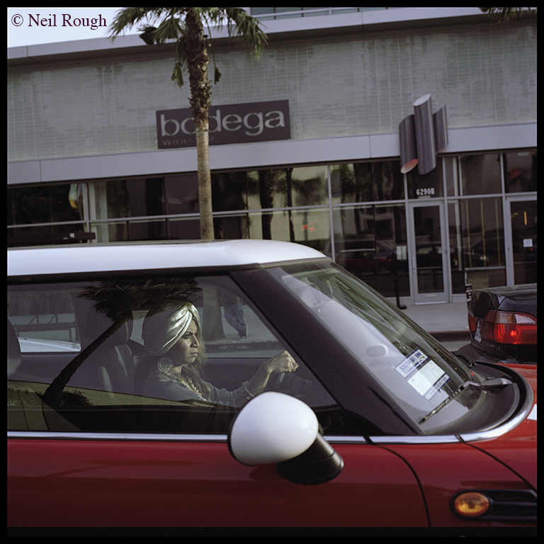 01. CA Hollywood Woman Driving Bodega.jpg