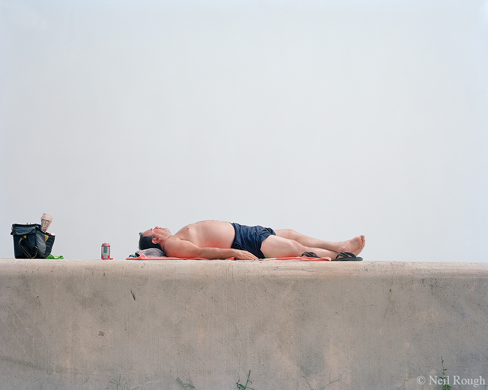 NH Hampton Beach Man Sunning 2013.jpg