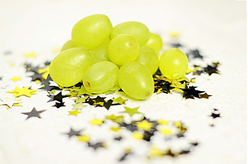 We love this Spanish tradition; eat twelve grapes when the clock strikes midnight and you will have a year of prosperity. Put twelve grapes on a skewer and soak in white wine overnight, freeze and then roll in some sugar. Hand out just before midnight and to ensure a prosperous and sweet New Year!