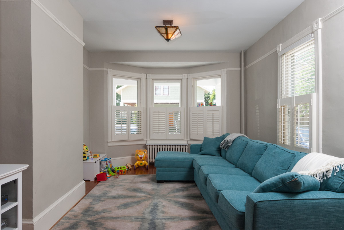 An unstaged living room. Try not to trip on any toys.
