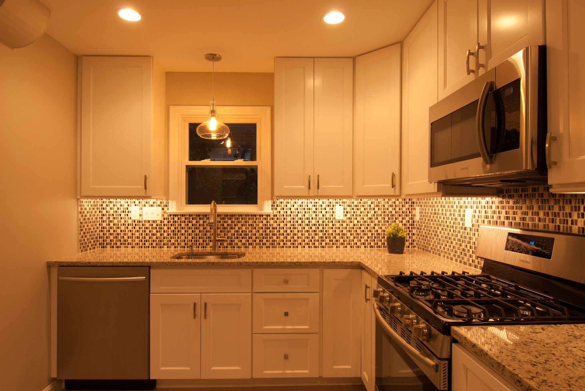 Ambient light photo of the kitchen. Check out that window!