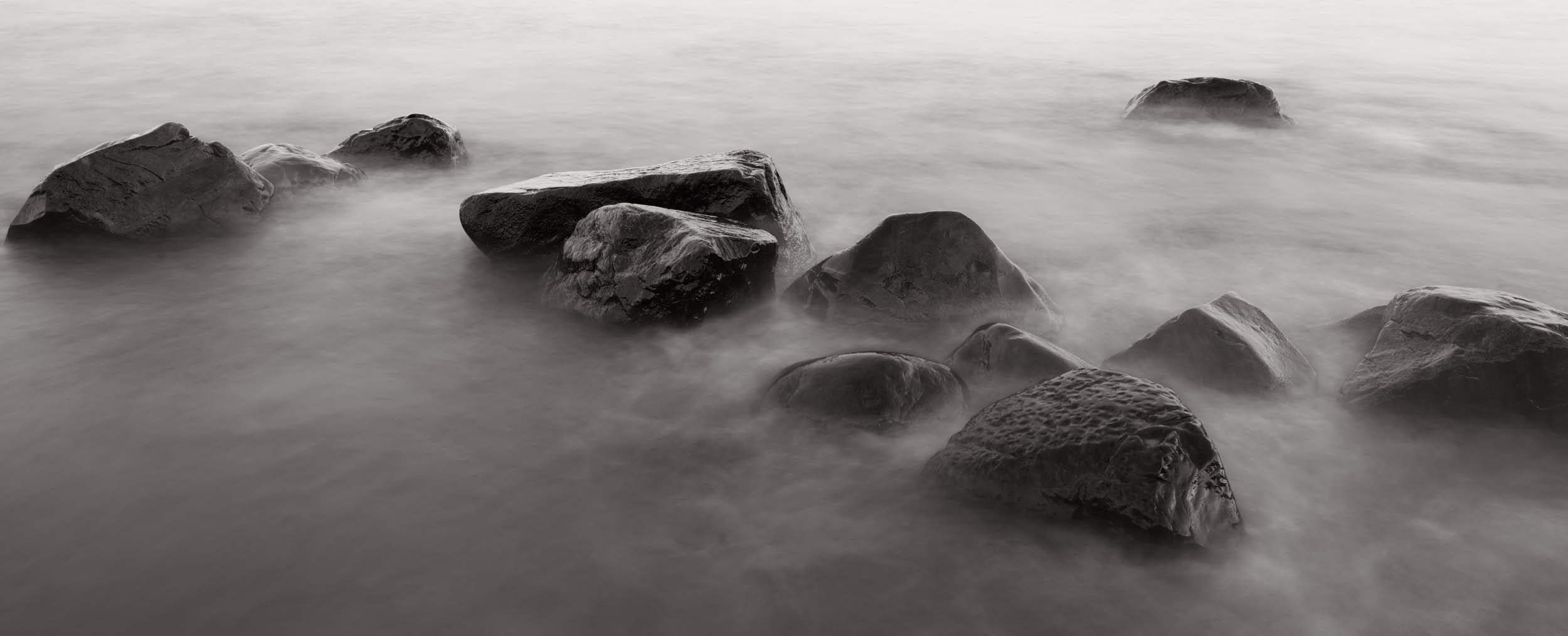 I love the rocks that sit along the shore of Little Presque Isle. Its fun to study them and notice the shapes, line, structure, wrinkles, pores, expression of each one. Michigan Landscape Photography.