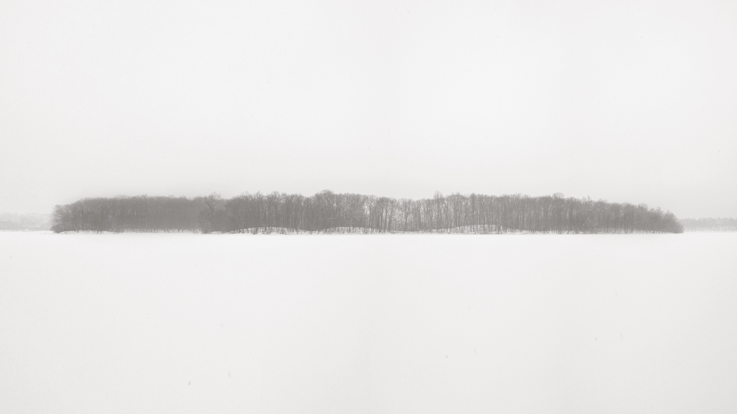 Island on Kent Lake from Turtlehead Point. Eight inches had already fallen overnight and the morning promised a few more. Snow was falling hard while I took this photo. Michigan Landscape Photography.