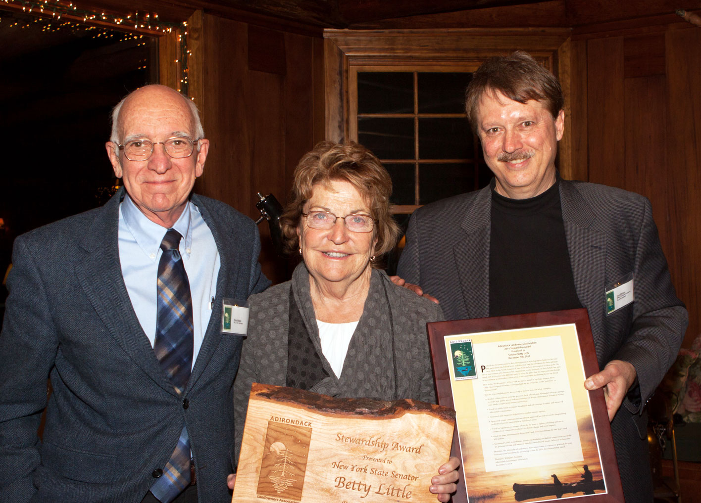 Senior Advisor Ross Whaley and President Tom Williams present the 2014 Stewardship Award to Senator Betty Little.