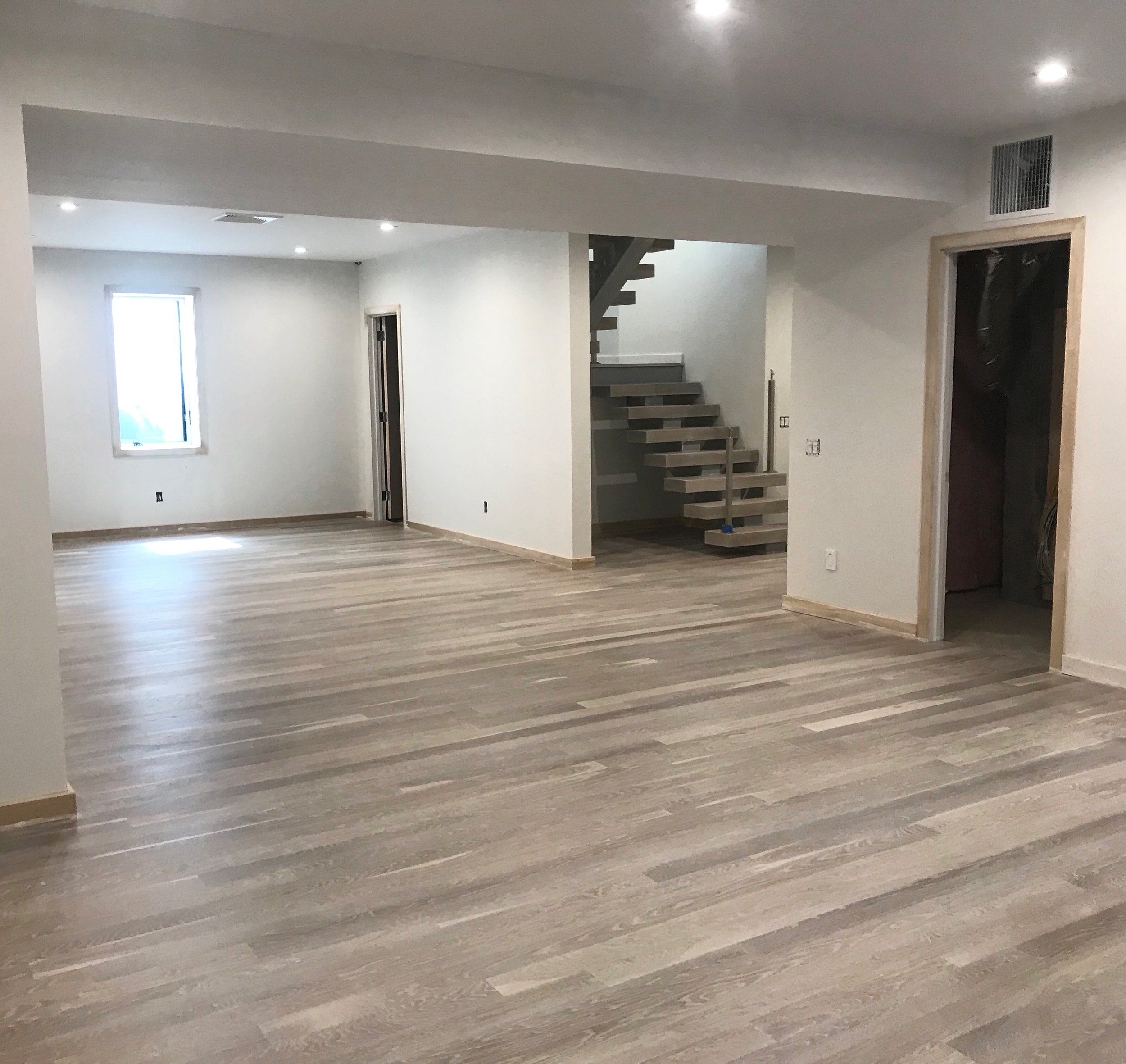 "Beautiful 4"" White Oak Engineered wood floor we installed in a basement in Sag Harbor, NY this winter.  The floor was unfinished, and we recently sanded and finished it with Woca Driftwood Lye White and Woca Color Oil Extra White hardwax oil.  Engineered flooring gives you the opportunity to make your basement flooring look just as high end as the rest of the house!  In this particular project, we installed a 4"" White Oak solid on the upper 2 floors, and sanded and finished all the floors exactly the same."