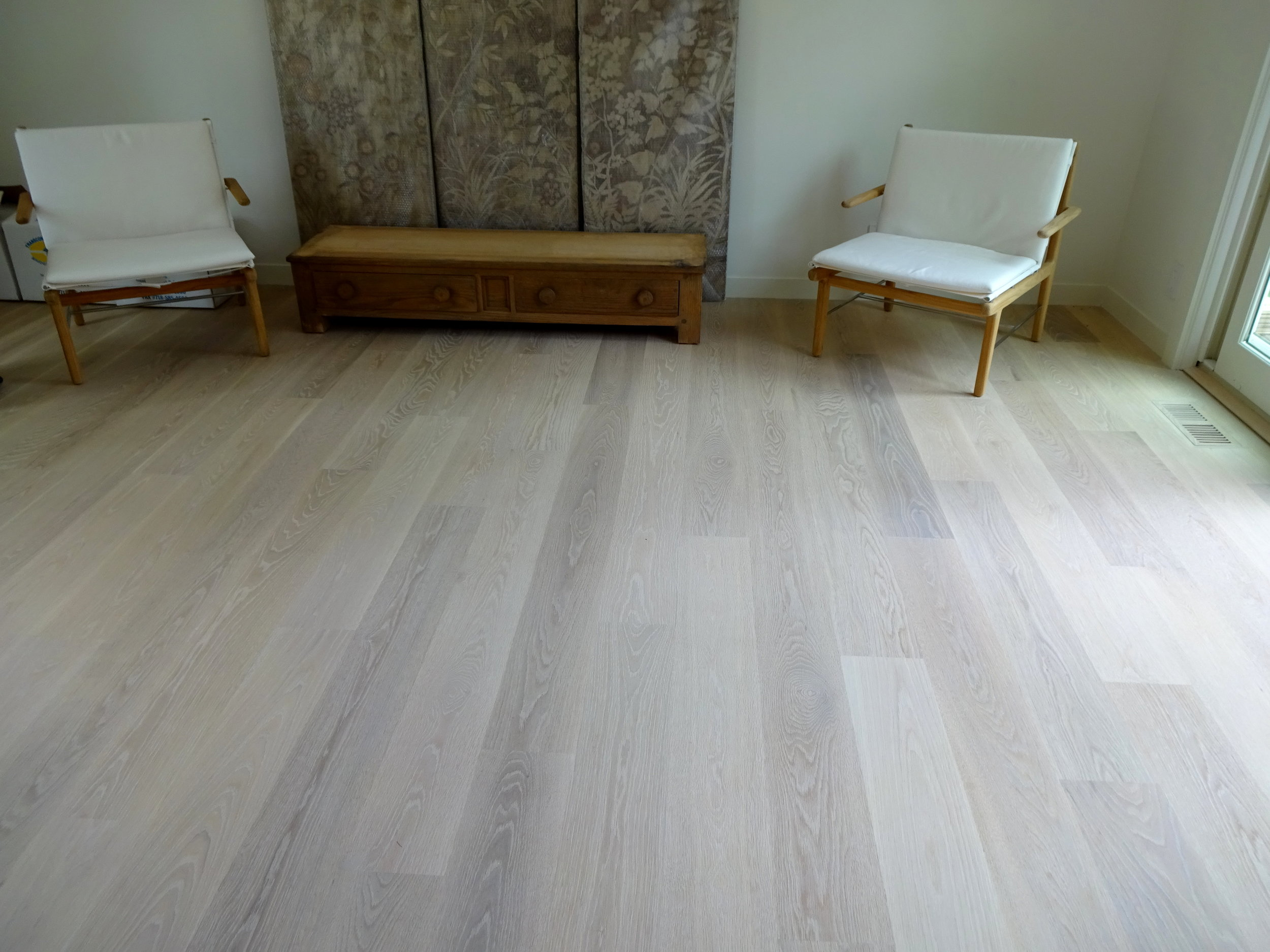 """7"""" Engineered White Oak Hardwood flooring that we installed & finished with Woca penetrating oils in Amagansett, NY in 2016. This picture was taken more than a year later and look! There is hardly any separation in the floor."""